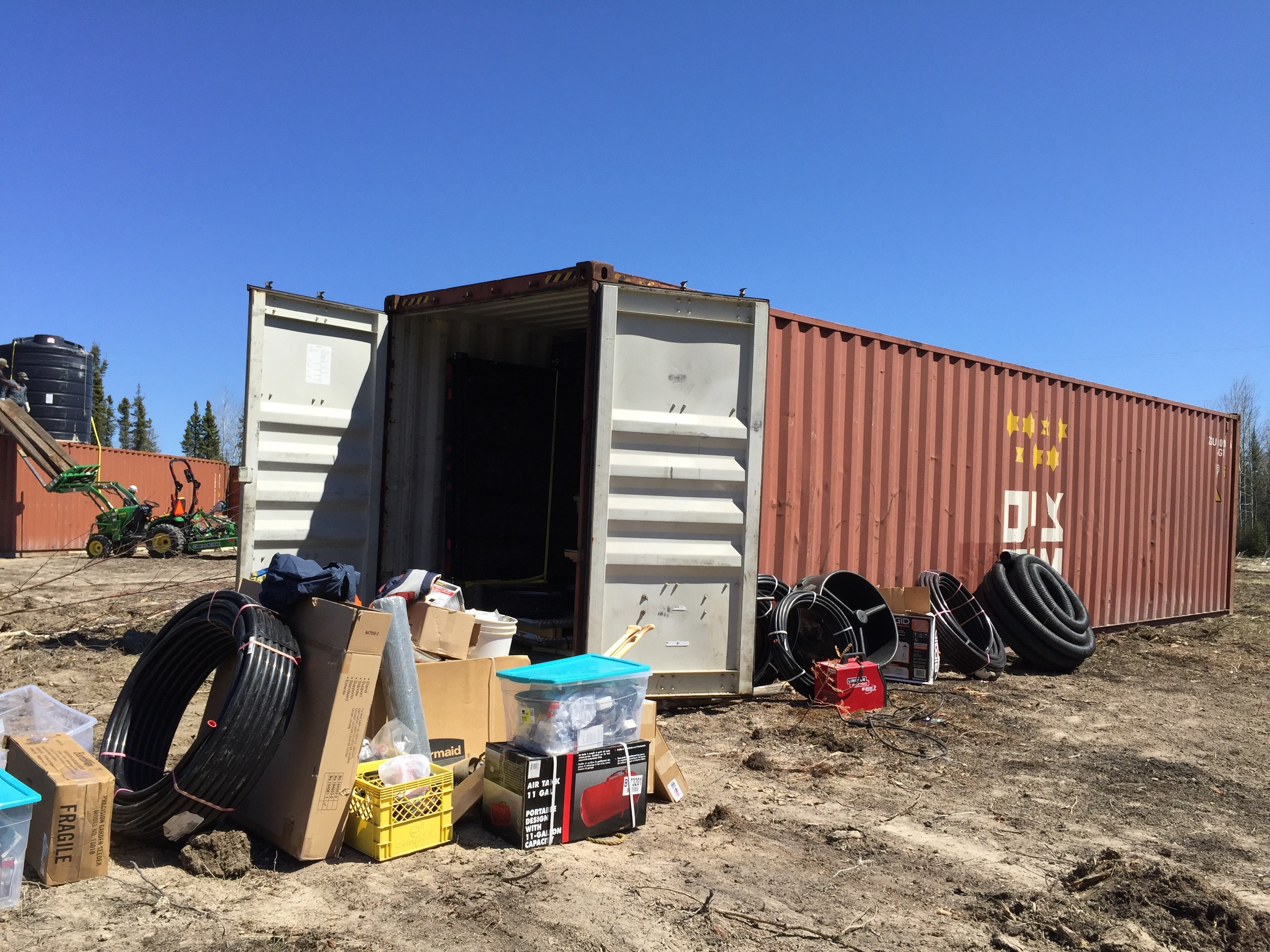 Unpacking the shipping container.
