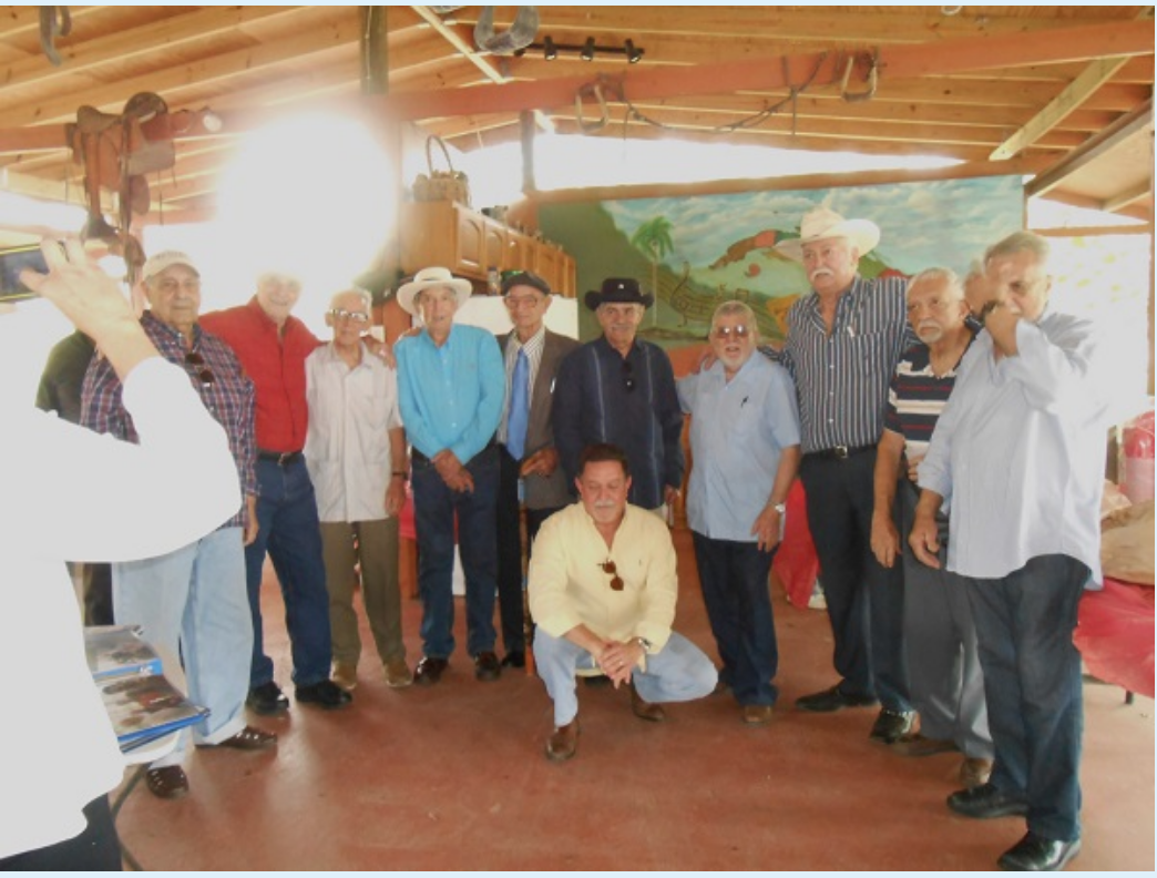 Finca Media Luna, Miami, October 2015. Far left in pale jeans: Guillermo Novo Sampol. 4th from left, in blue shirt & white hat: Luis Posada Carriles.