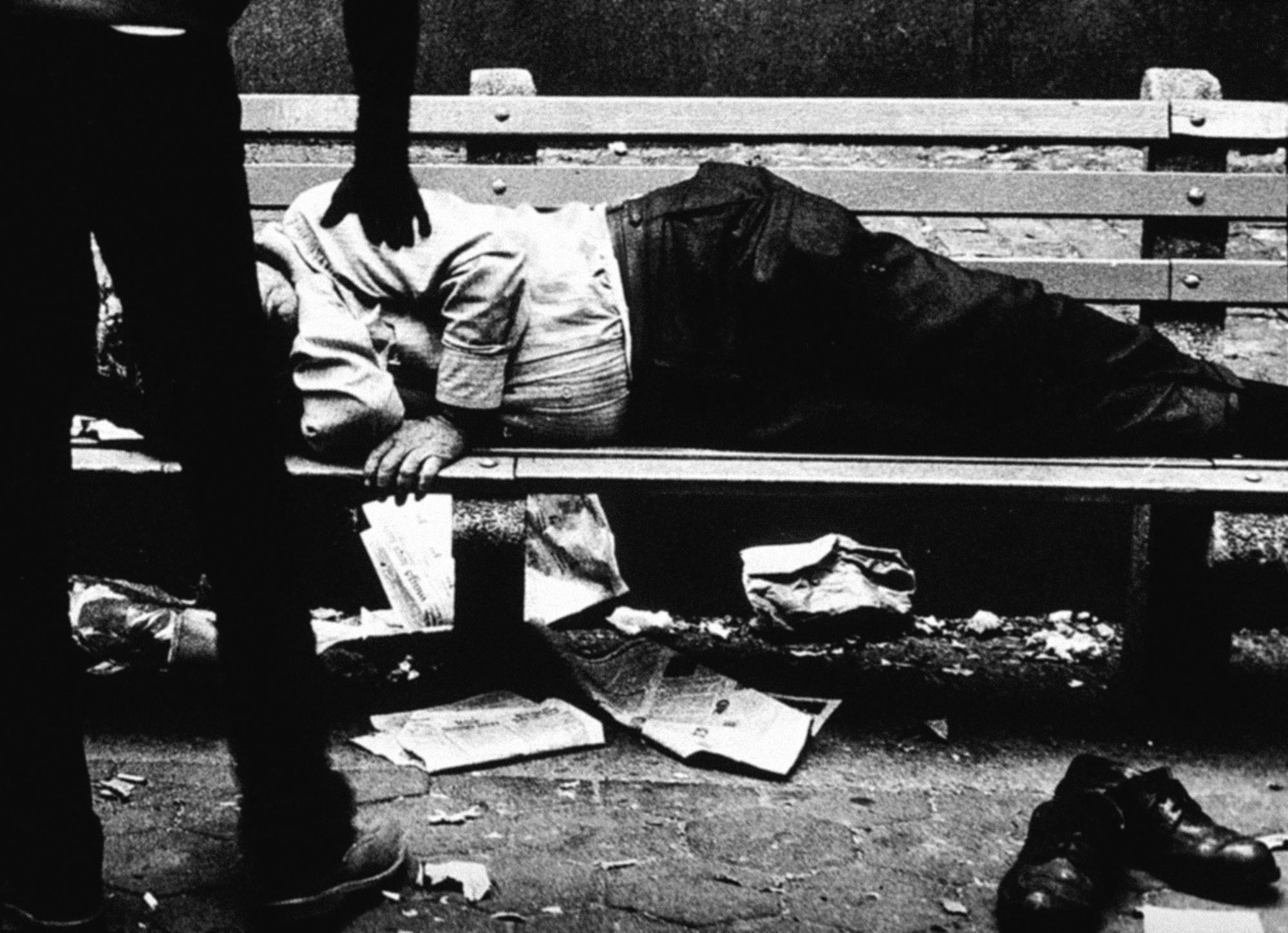 robbing homeless man.jpg