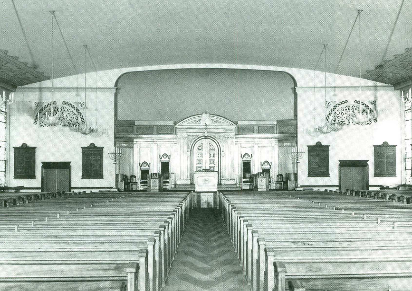 Beth Sholom's founding synagogue in Philadelphia (1919), prior to their suburban relocation to Wright's synagogue. The format of the sanctuary follows typical pew-based Christian configurations un-segregated by gender.