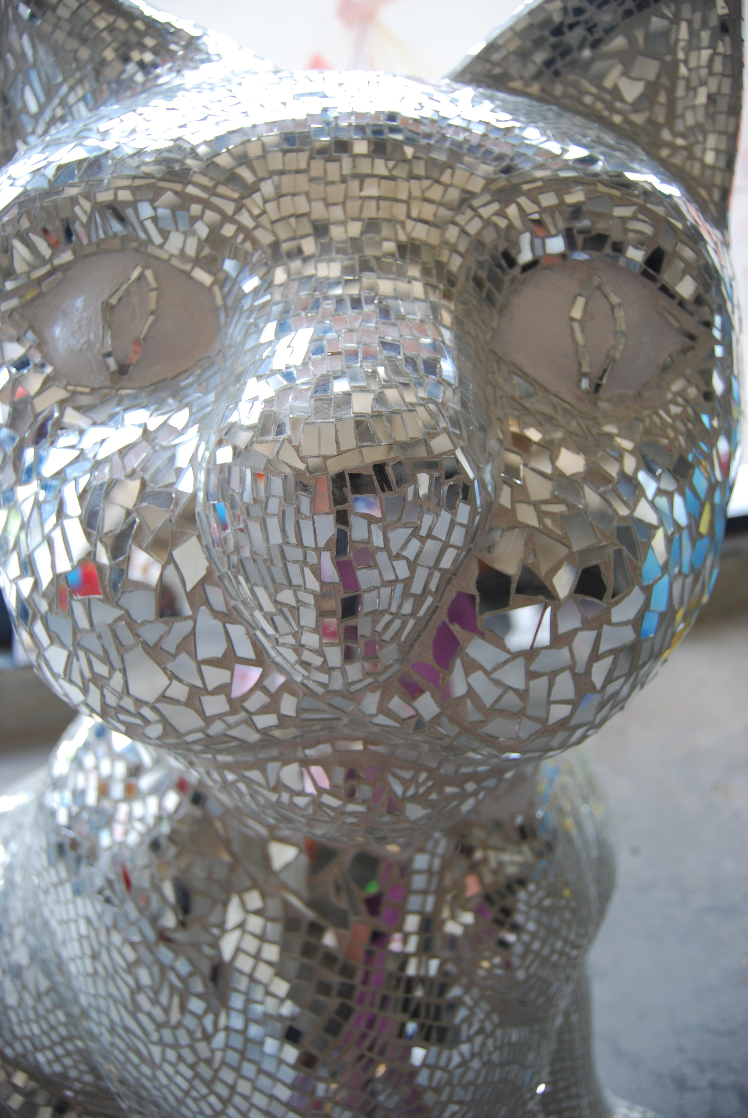 """InCatdescent Zeus"" Hand cut glass mirror mosaic cat sculpture by Shelita Birchett Benash. 5'H x 2.5'W x 4'L, 2010. Stamford Downtown Art in Public Places. ""It's Reigning Cats and Dogs"""