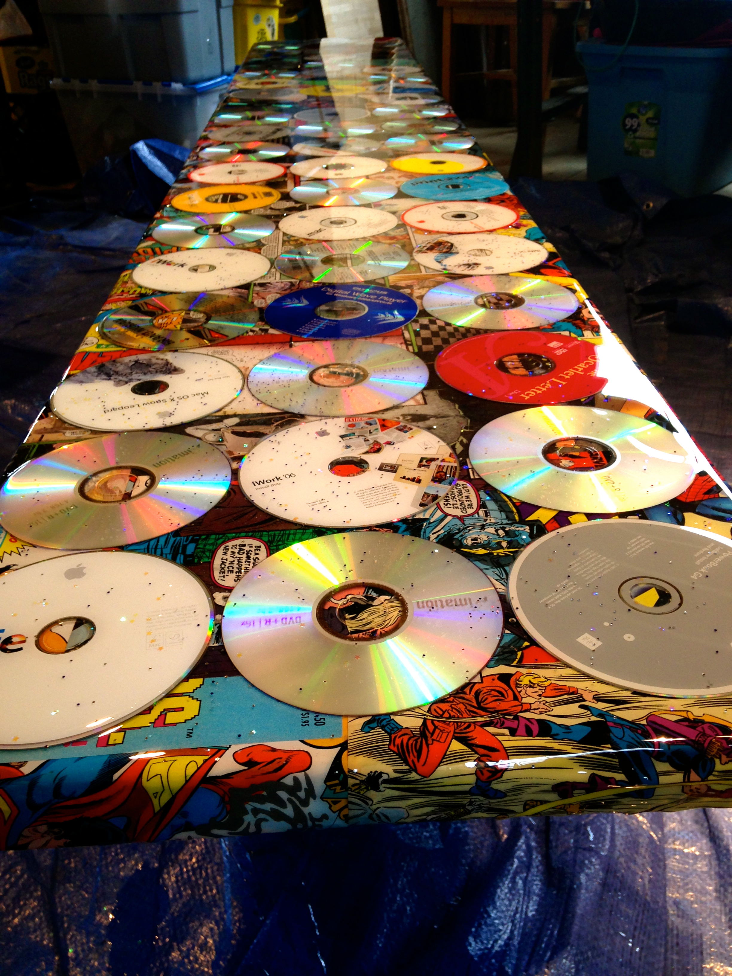 """Salvaged Comics & CD's Bench"" Assemblage by Shelita Birchett Benash"