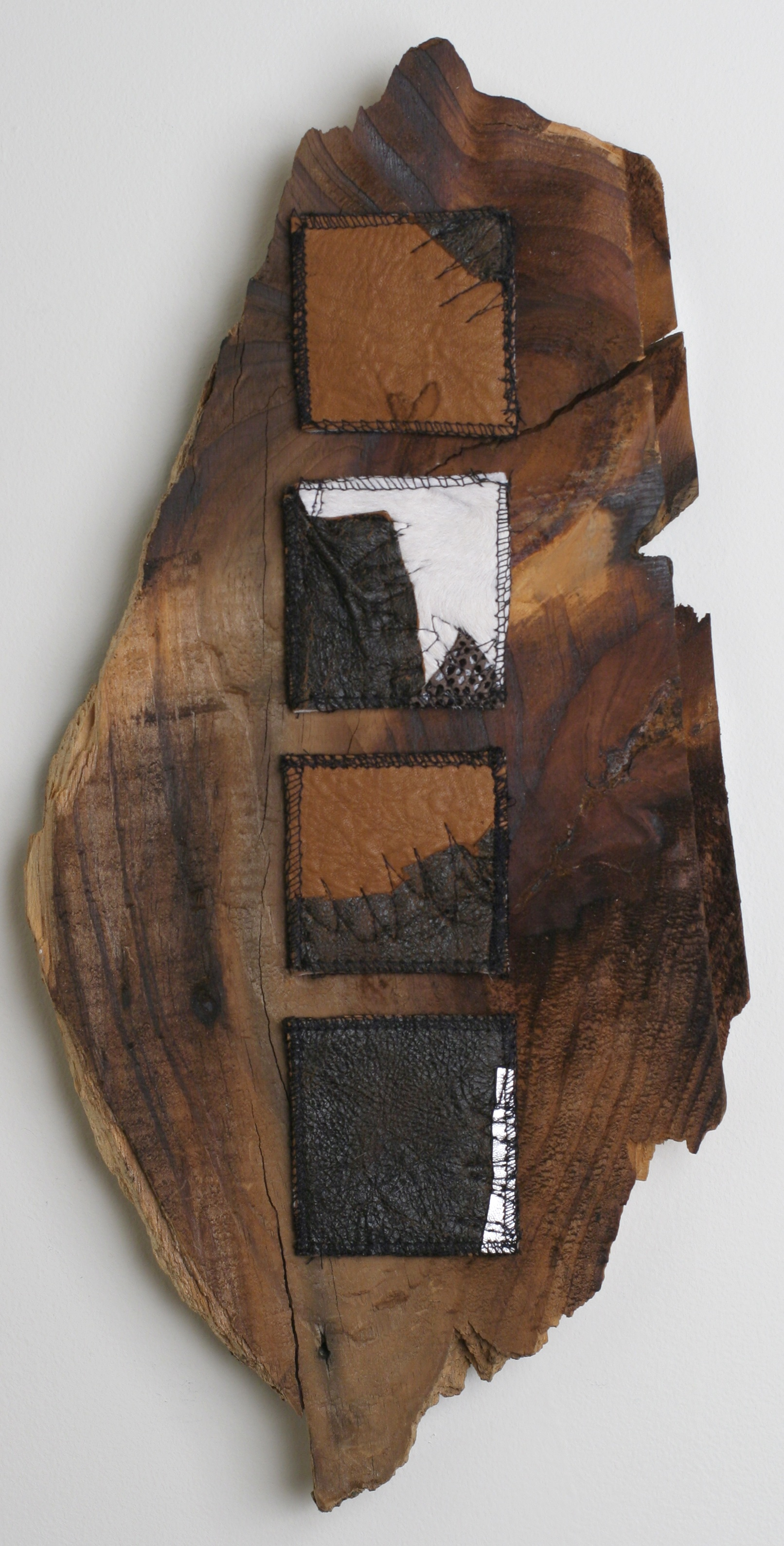 """Porch"" Antique wood salvaged from the demolition of my front porch. Hand pieced leather quilts. 8""w x16""L. 2004."