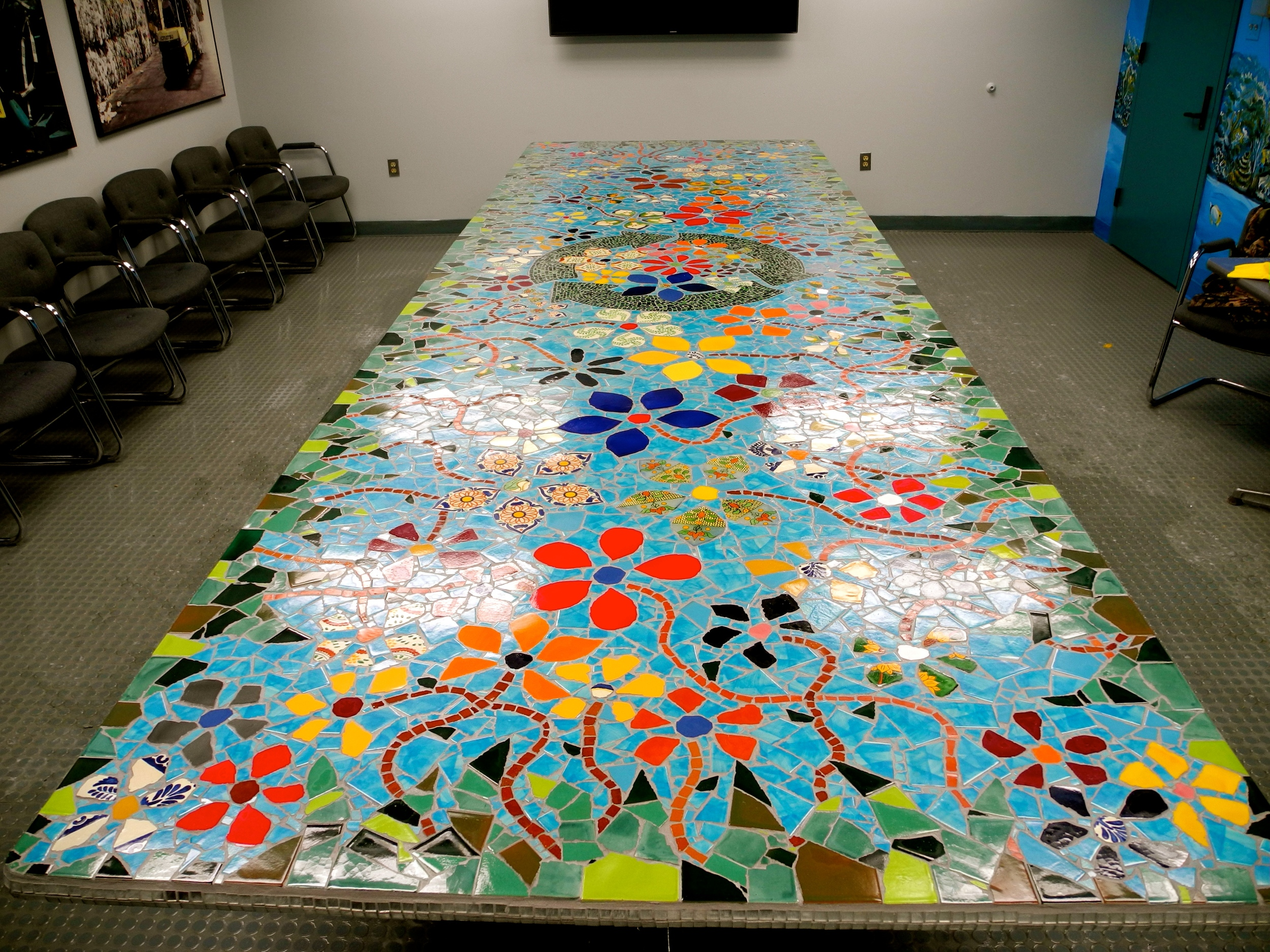 Mosaic conference table up-cycle comission work in progress. Grouting the edges. Will soon be done! 16' x 5'. 3/29/14.