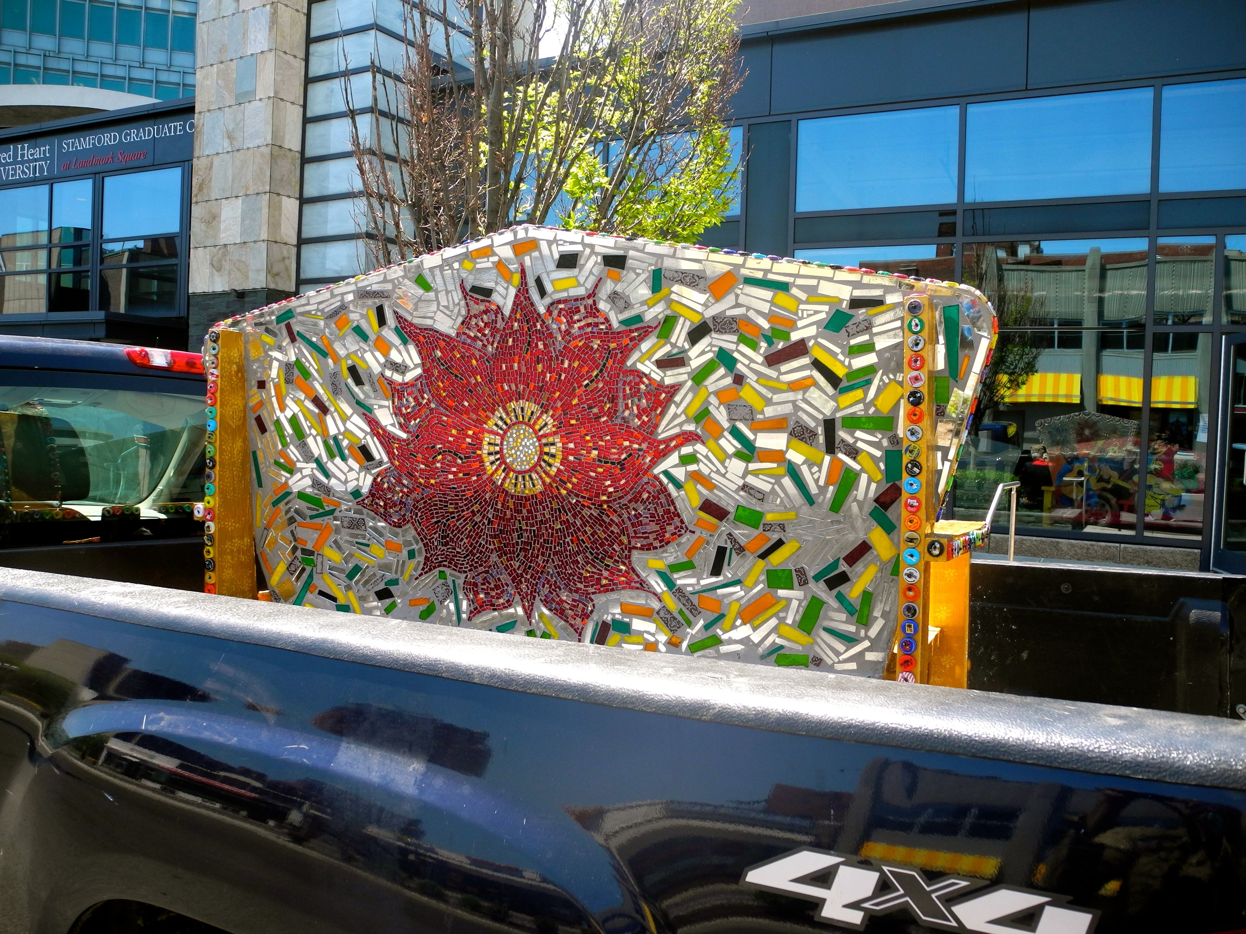"""Flower Power"" glass mirror mosaicked bench drop-off in Stamford, CT."