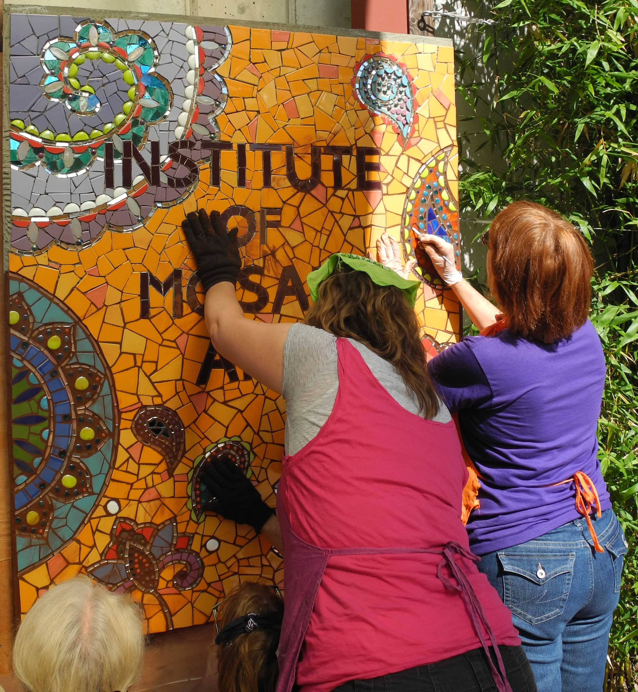 Production team working on Laurel True's mosaic mural at the Institute of Mosaic Art in Berkeley, CA.