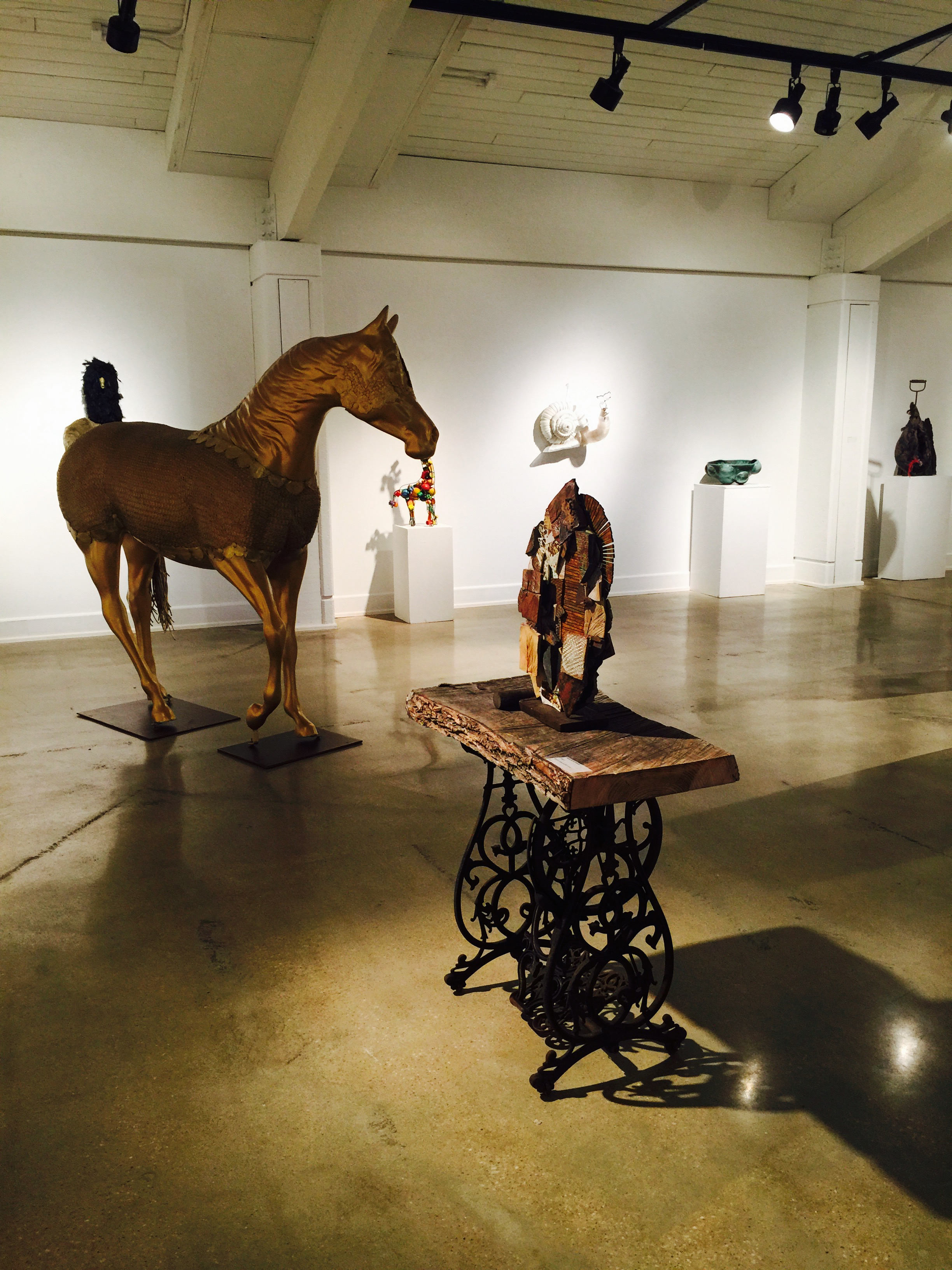 """HELIOS HORSE"" (LEFT) MIXED MEDIA MOSAIC ON FIBERGLASS BY SHELITA BIRCHETT BENASH OPENING RECEPTION JUNE 28, 2015  ""CONJURE"" (RIGHT) HIGH FIRE CERAMIC MIXED MEDIA MOSAIC SCULPTURE BY SHELITA BIRCHETT BENASH WITH RECYCLED ART TABLE BY RICHARD BENASH"