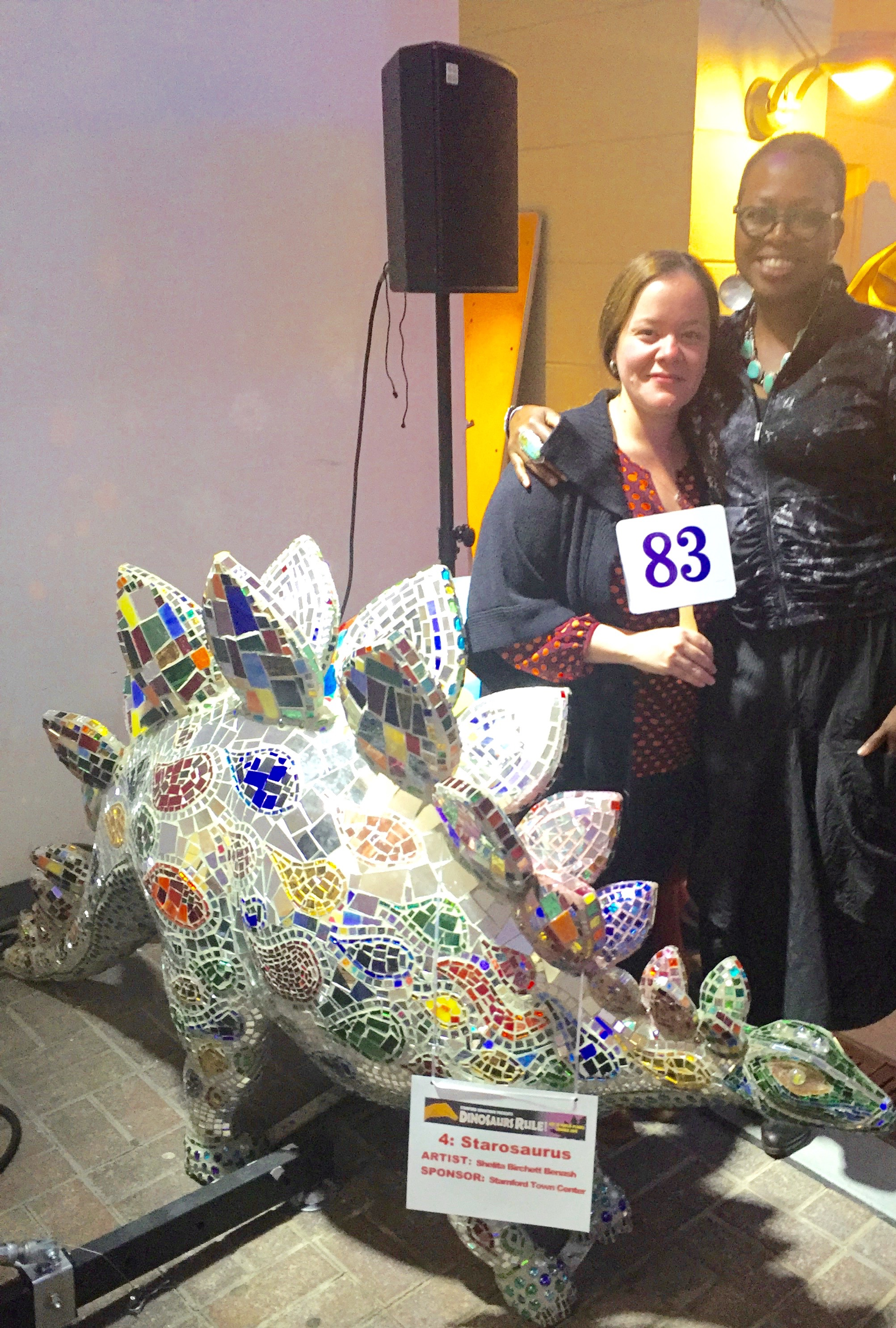 "With Yadira Astacio the winner bidder of my stained glass and mirror mosaicked ""Starosaurus."""