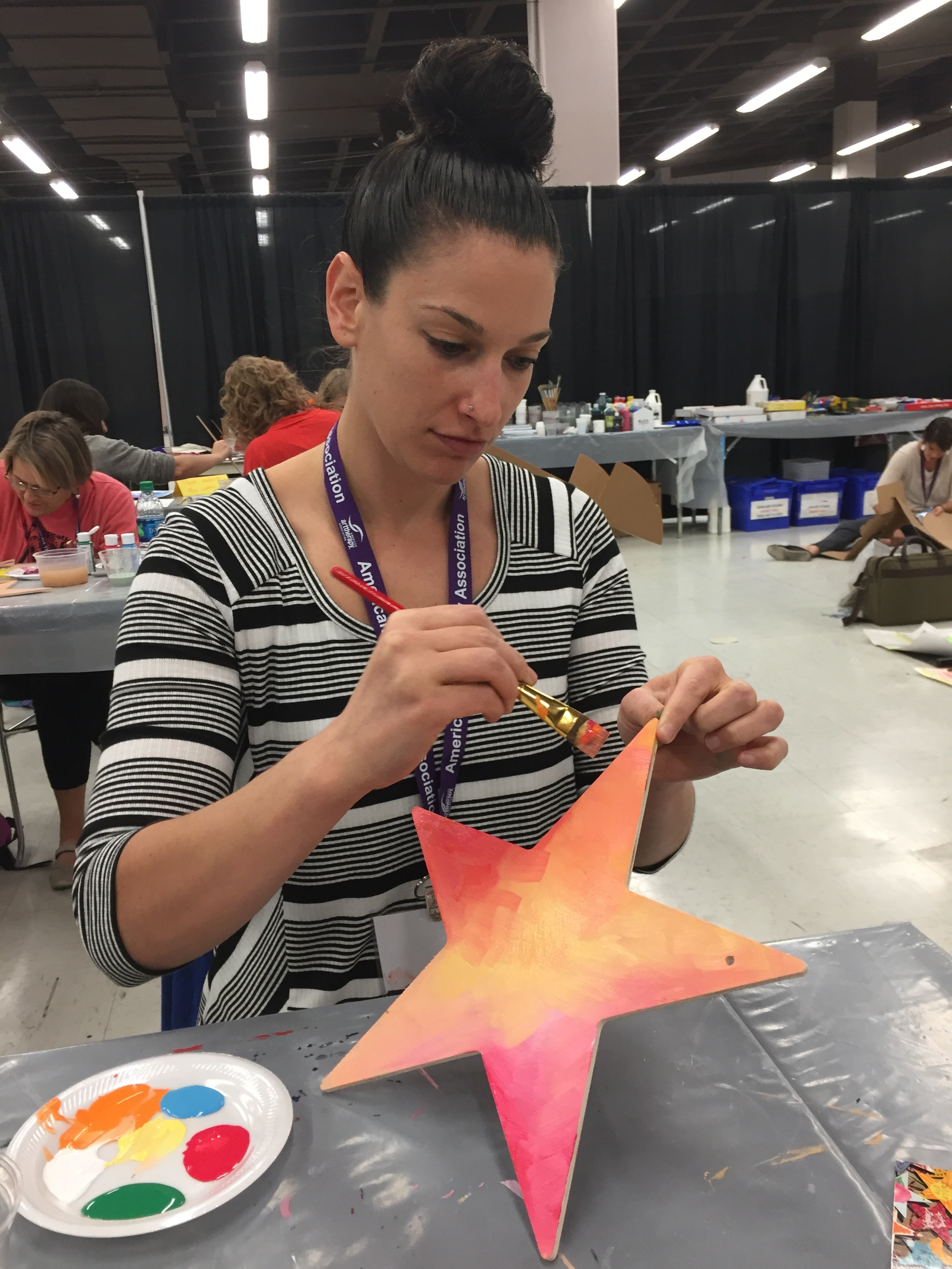 Sigal Govrin painting a star of hope to be sent to Sutherland Springs.