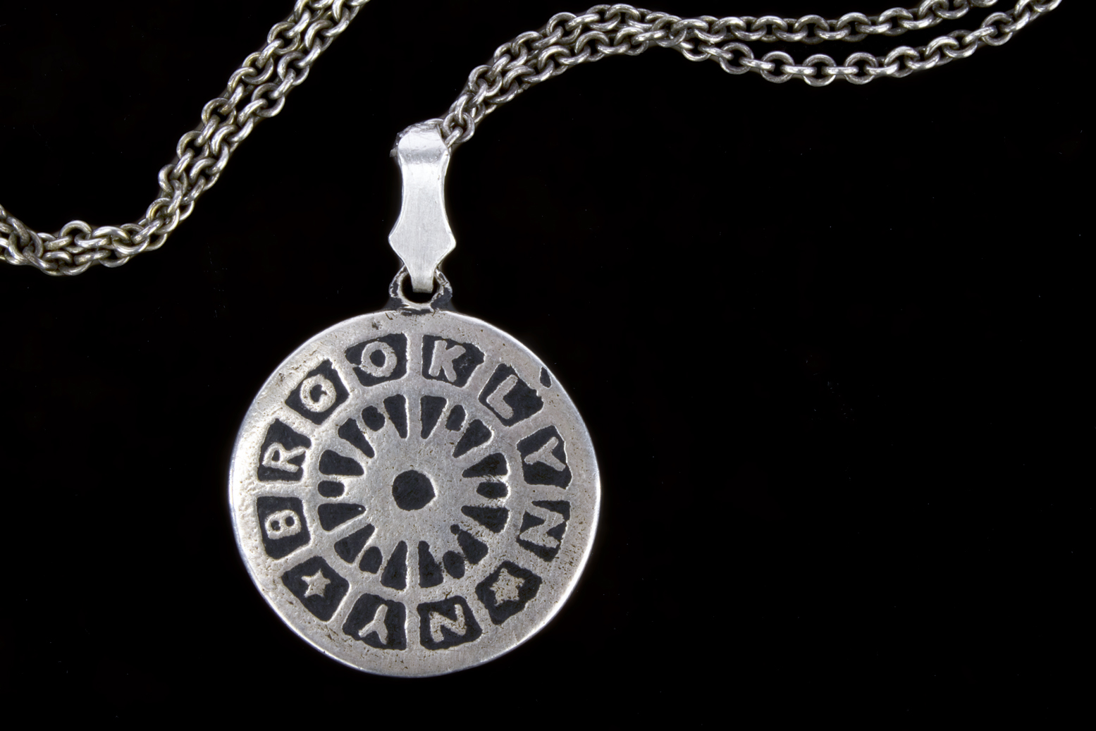 manhole cover_silver necklace_1.jpg