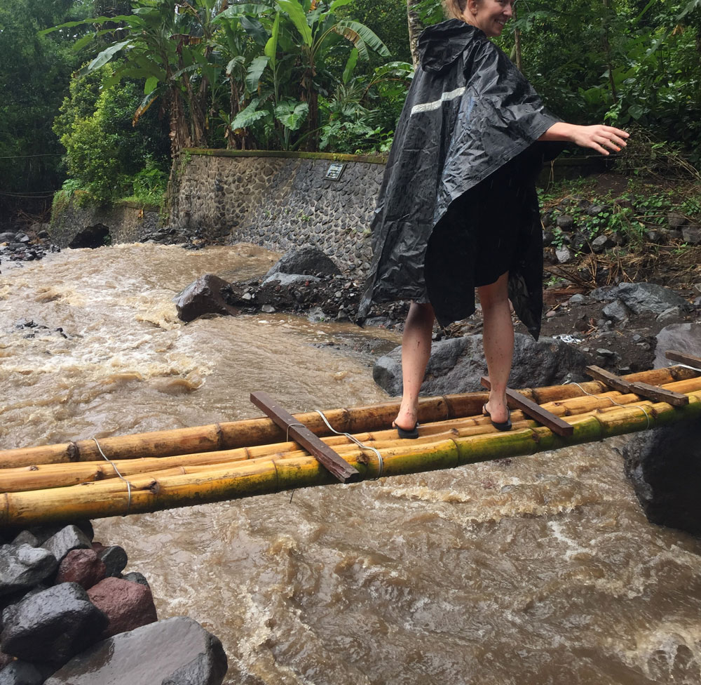 "On a hike to a waterfall, we crossed a raging stream on this slippery bamboo ""bridge"". And my friend did it in flip flops! Bravo!"