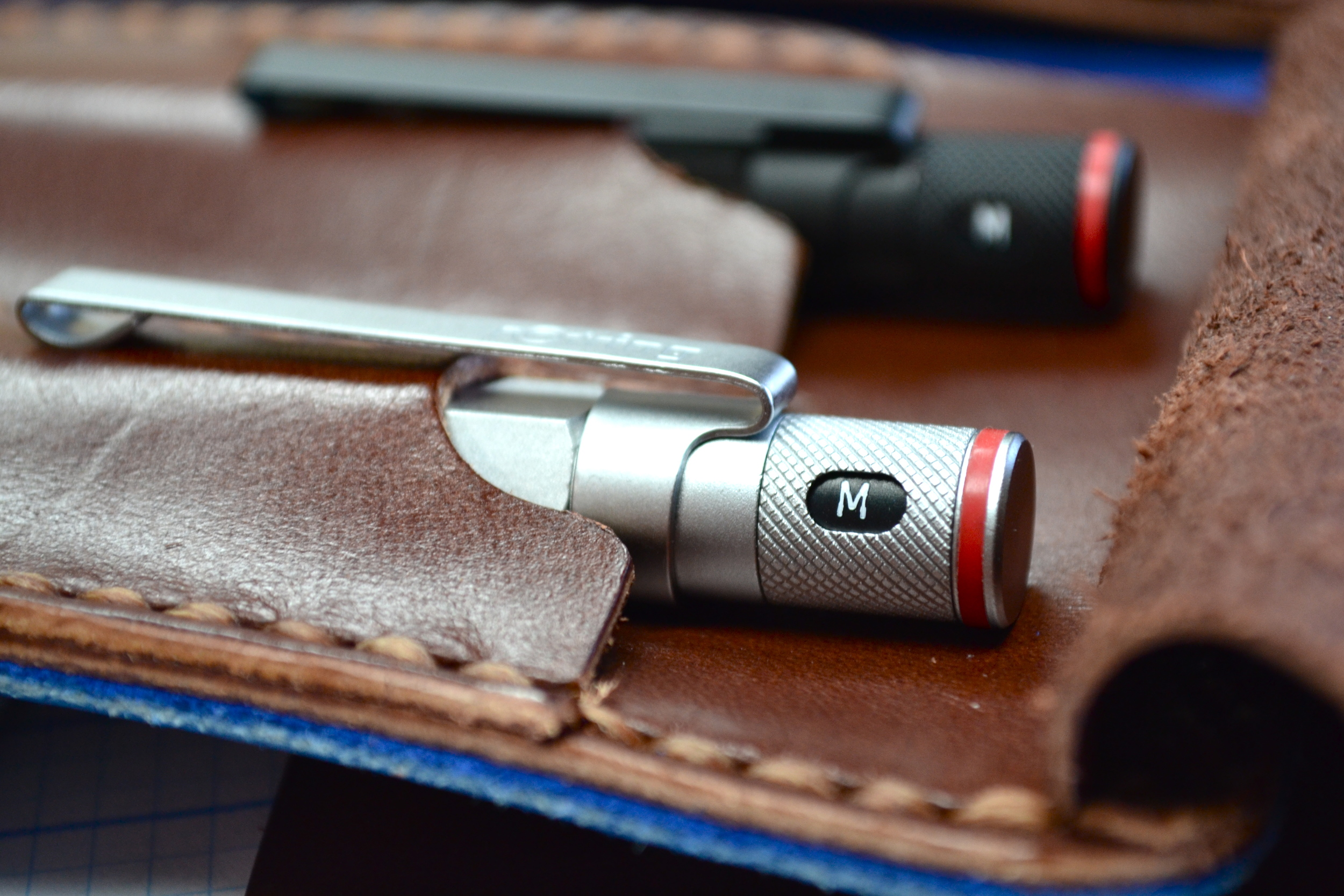 this is a silver rotring 600 fountain pen in a leather case