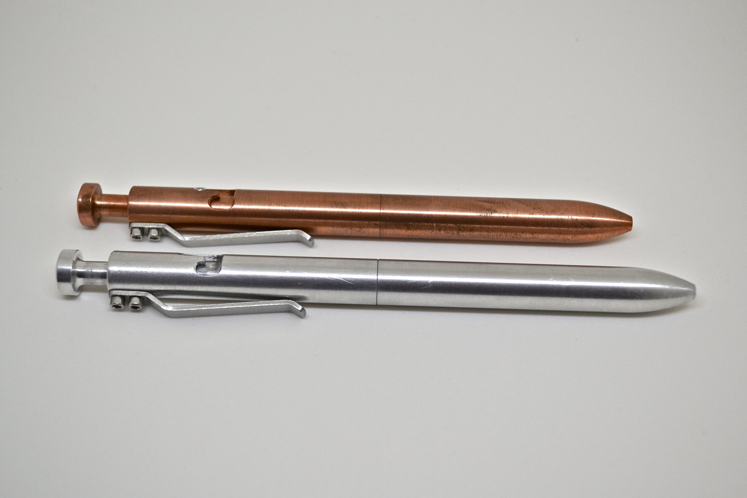 Aluminum G2 Bolt vs Copper Standard Bolt for Size Comparison