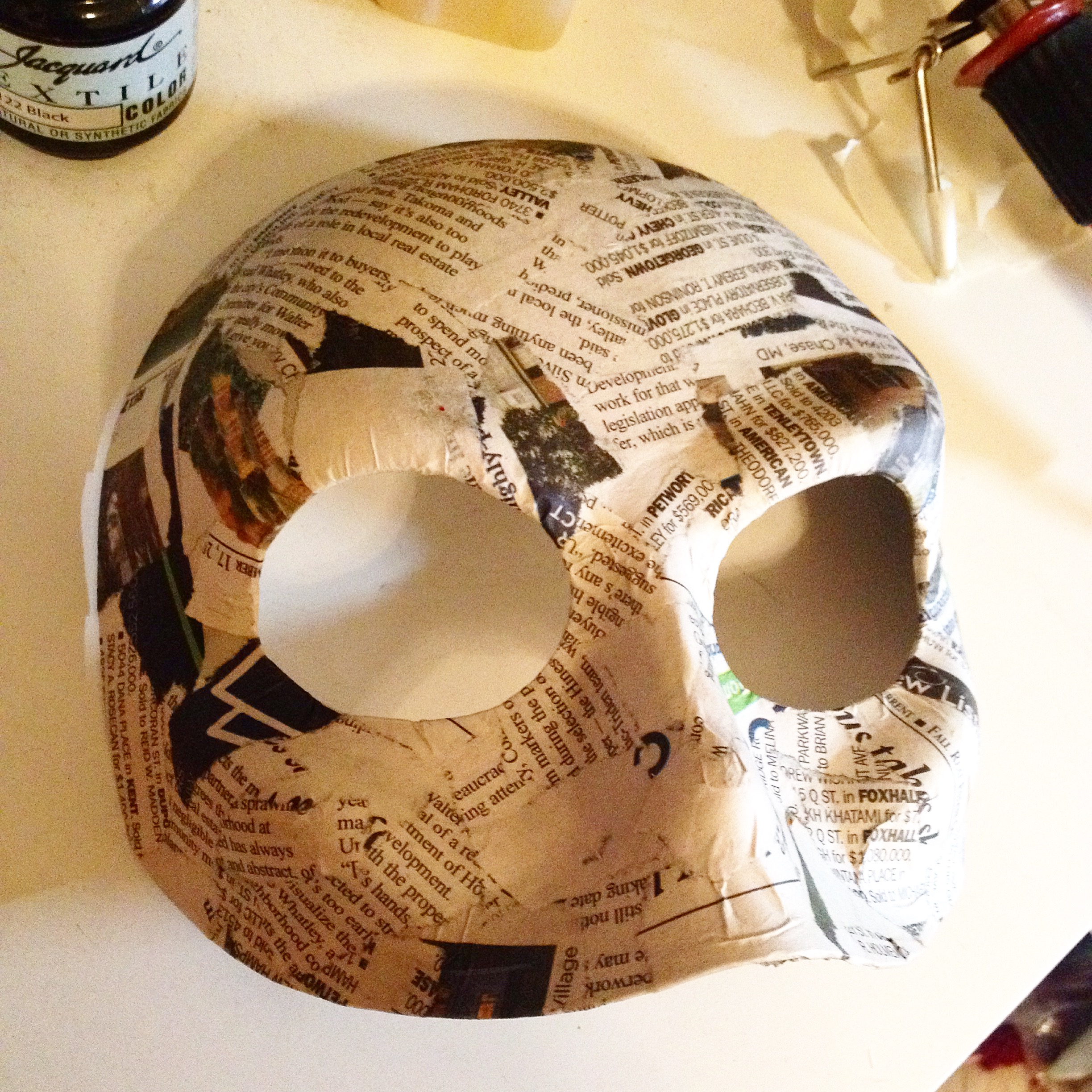 Cut down, reshaped and paper-mached base mask.