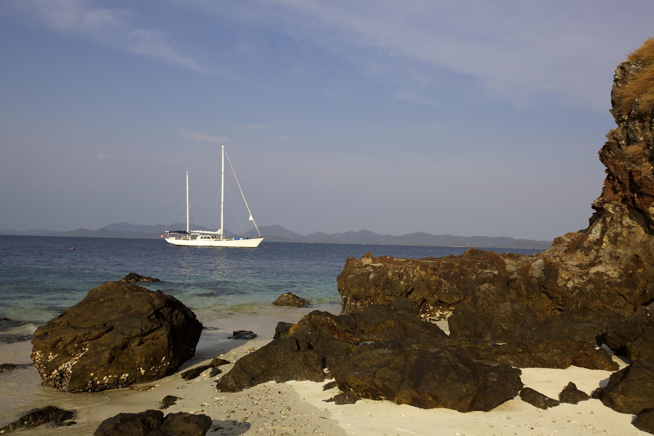 Meta IV anchoring at a rocky beach