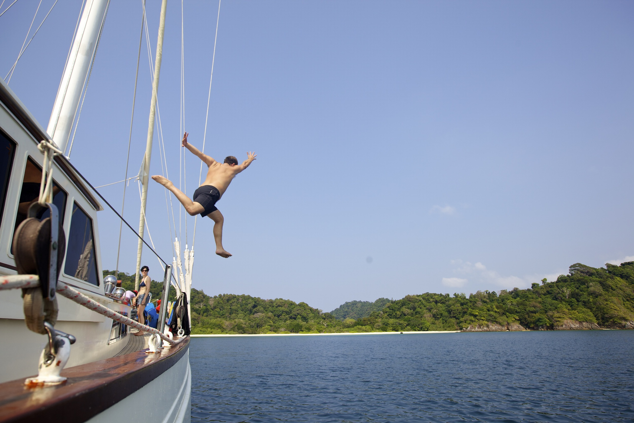 Jumping into the water next to a lonely island