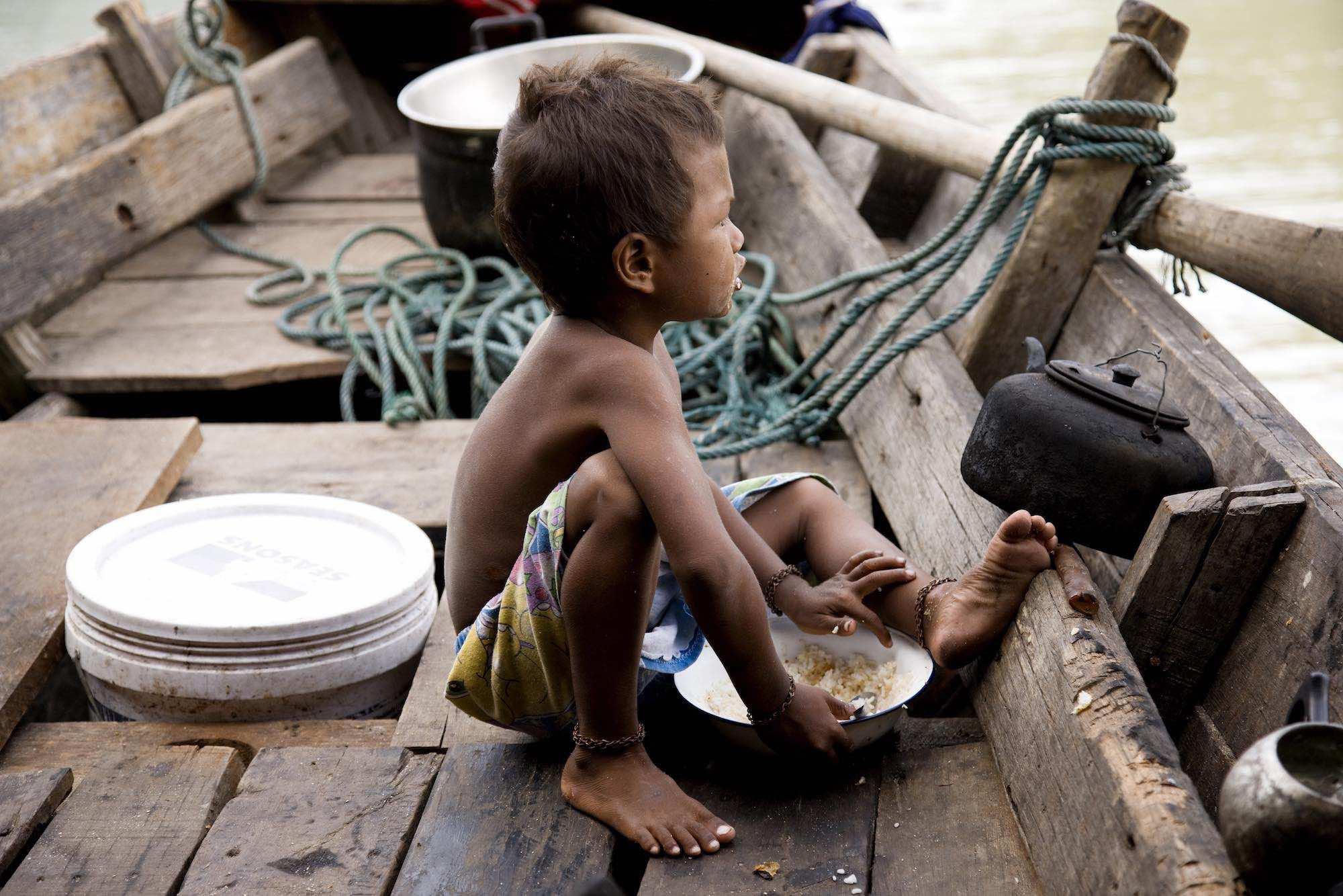 09.Bow eating rice on the Kabang.jpeg