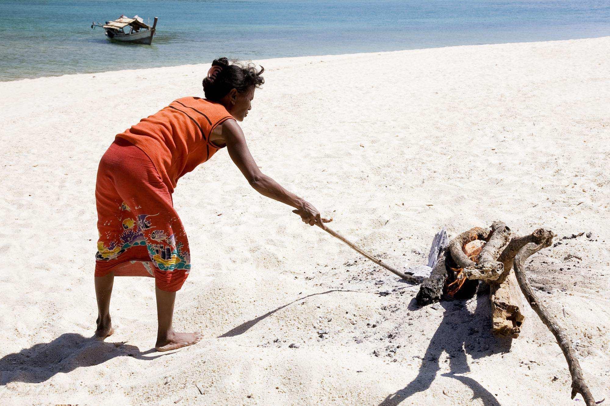 33.Sabai making charcoal near the Kabang.jpeg
