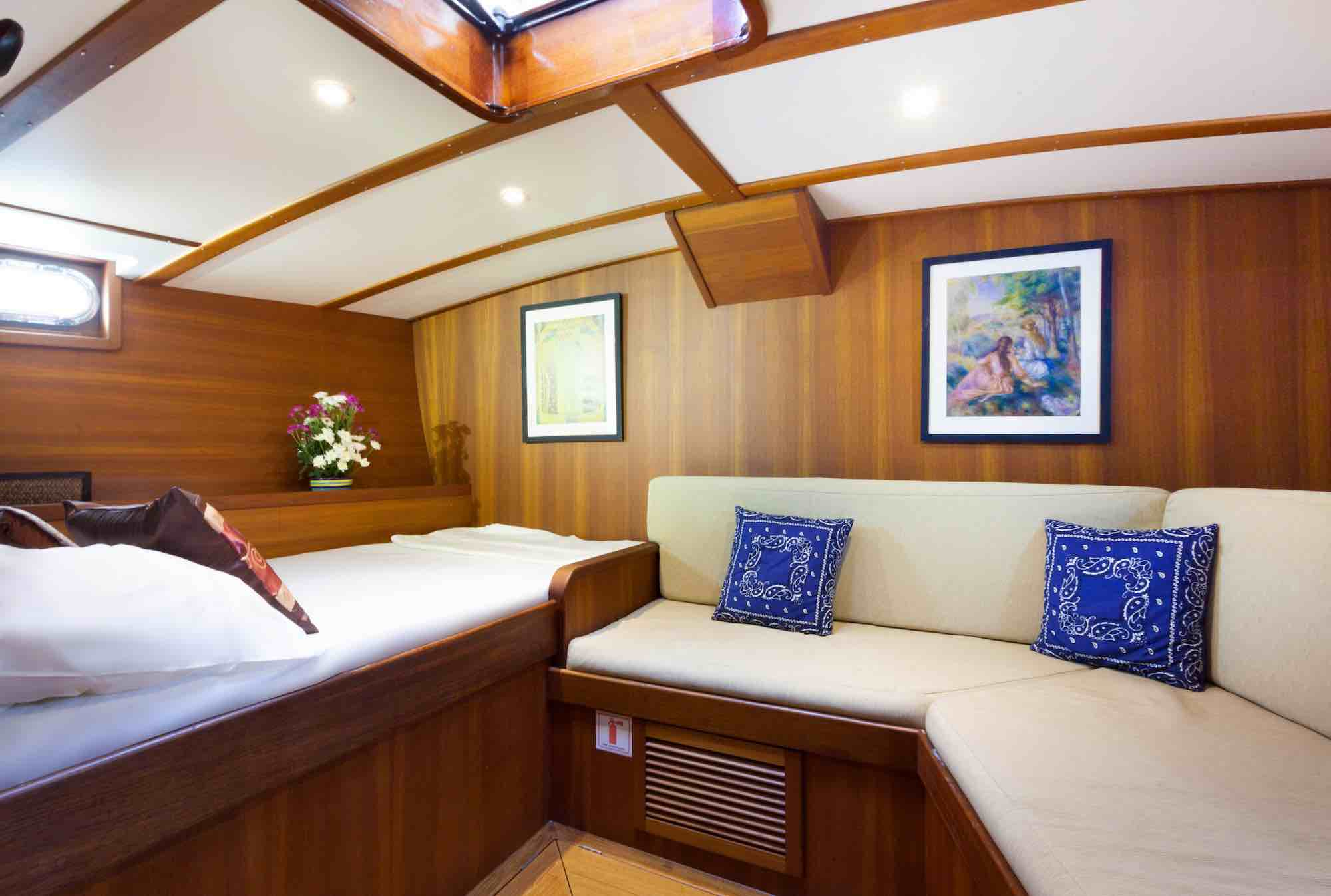 Jubilaeum_guest cabin-double bed-couch-nice throw pillows-sailing in Mergui_XS.jpeg