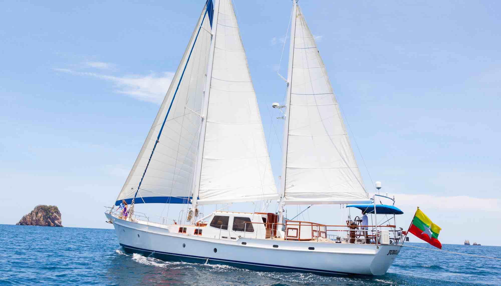 Jubilaeum_closeup of yacht sailing toward an island in Mergui Archipelago_XS.jpeg