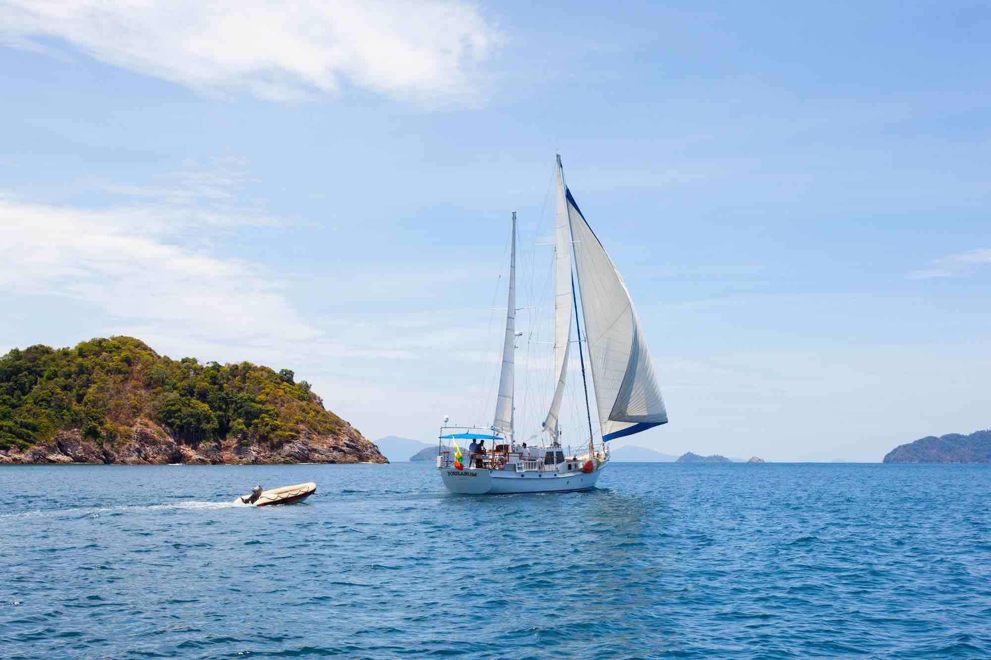 Jubilaeum_sailing full sail away from an island-tender sailing around in Mergui_XS.jpeg