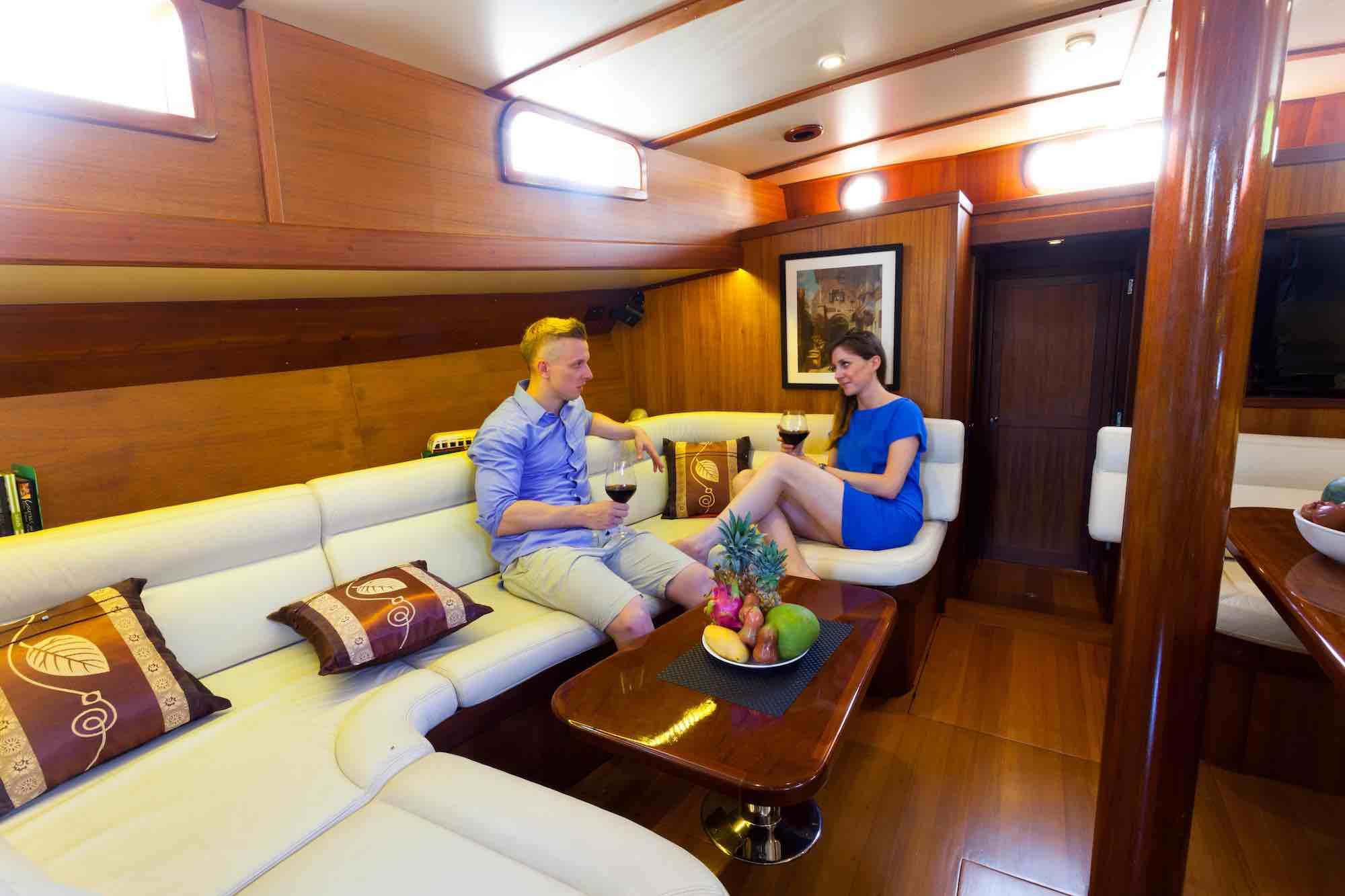 Jubilaeum_guest couple relaxing at lounge area on boat sailing in Moken_XS.jpeg