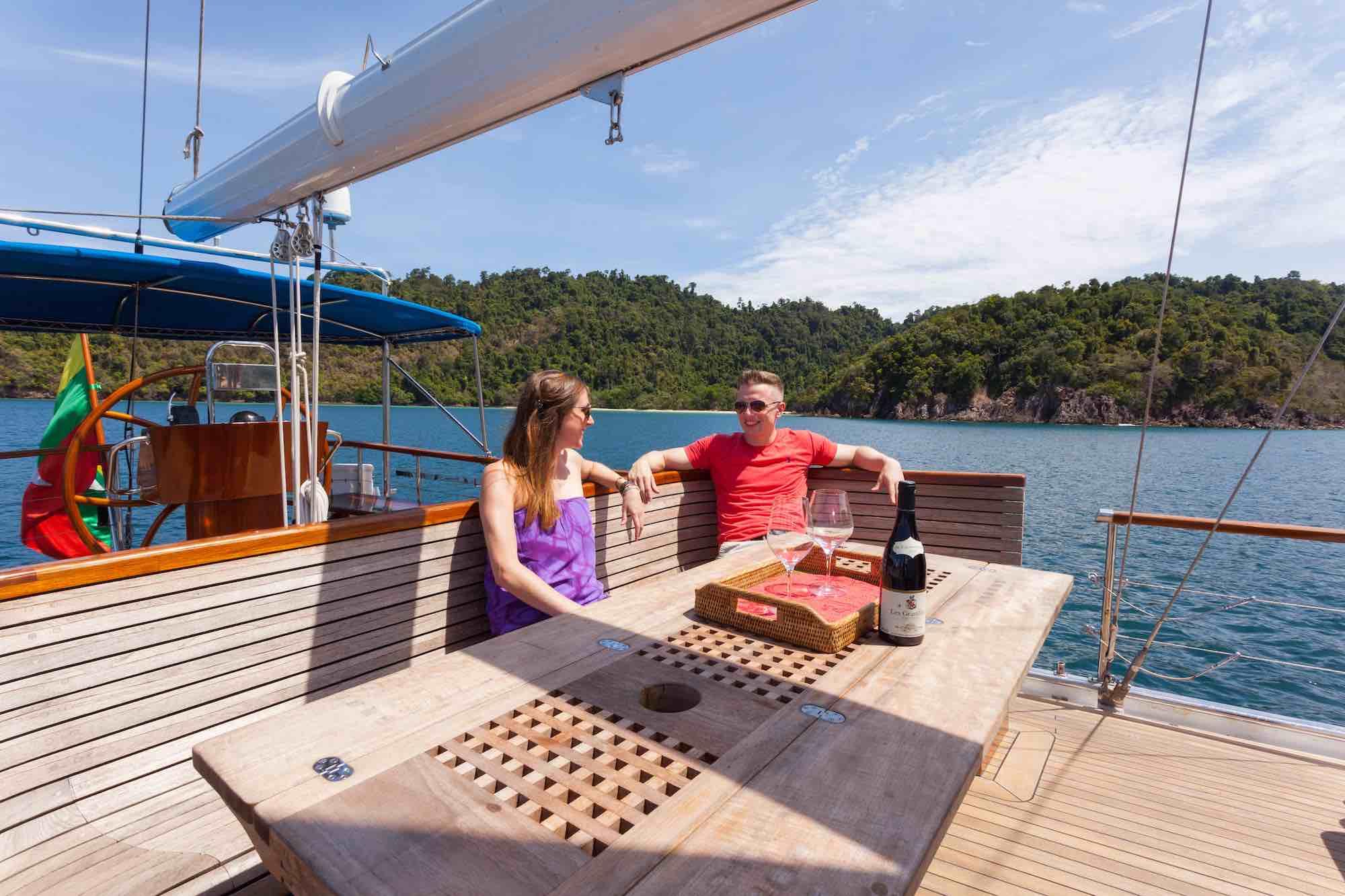 Jubilaeum_guest couple having fun on deck lounge sailing in Mergui_XS.jpeg