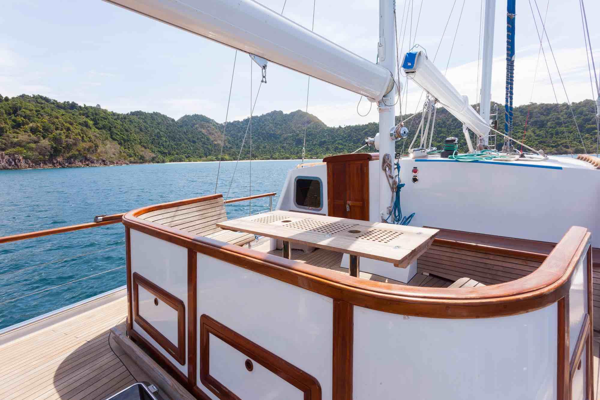 Jubilaeum_deck lounge anchoring by a beautiful island in Moken_XS.jpeg