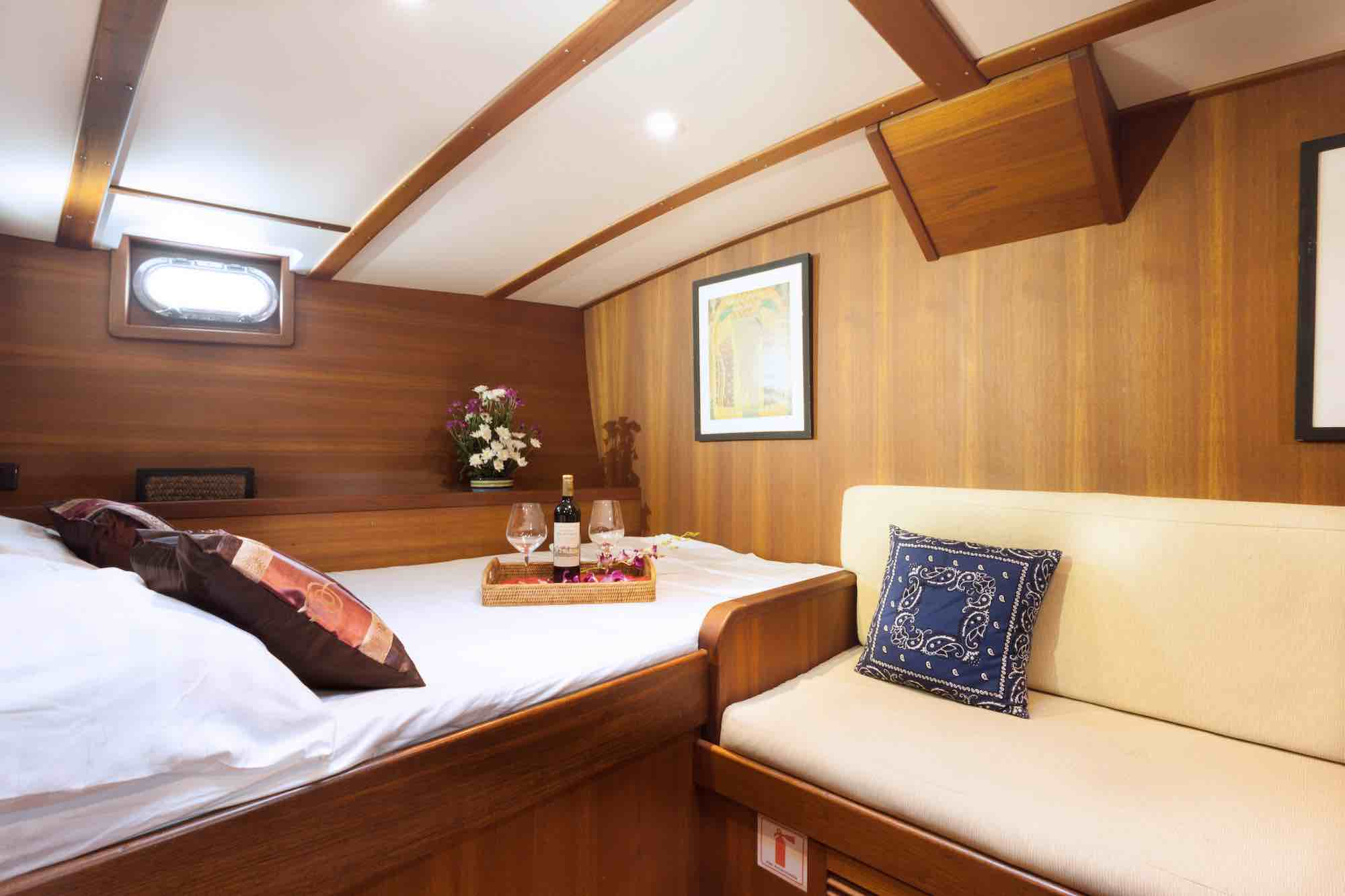 Jubilaeum_guest cabin-double bed-wine tray-brighter light-sailing holiday in Mergui_XS.jpeg