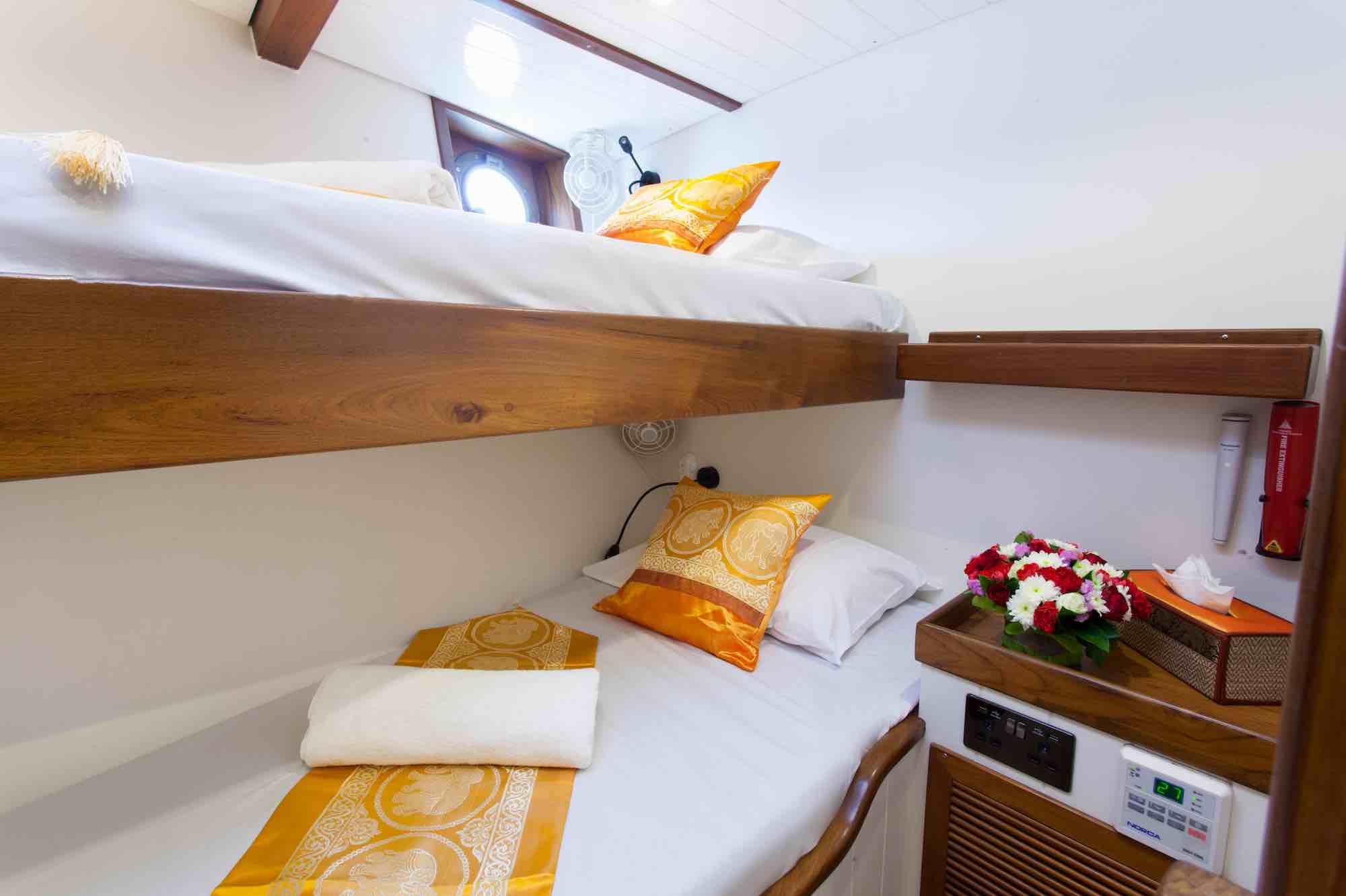 Dallinghoo_guest cabin bunk bed yellow throw pillows sailing in Mergui 2_XS.jpeg