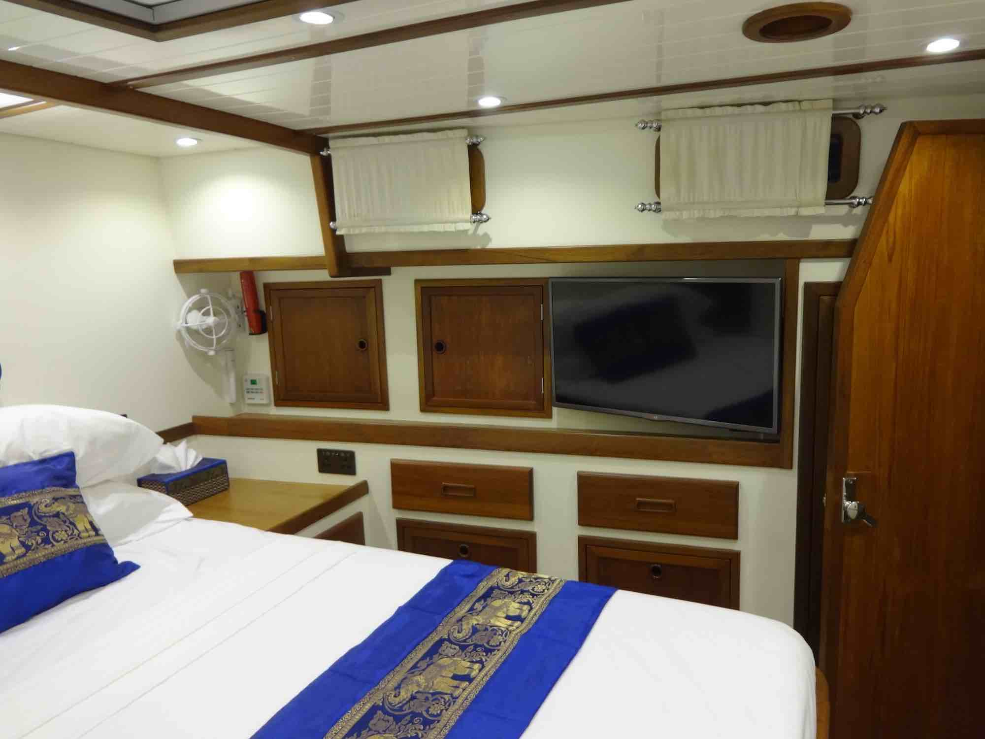 Dallinghoo_guest cabin blue throw pillows and TV yacht trip in Mergui_XS.jpeg