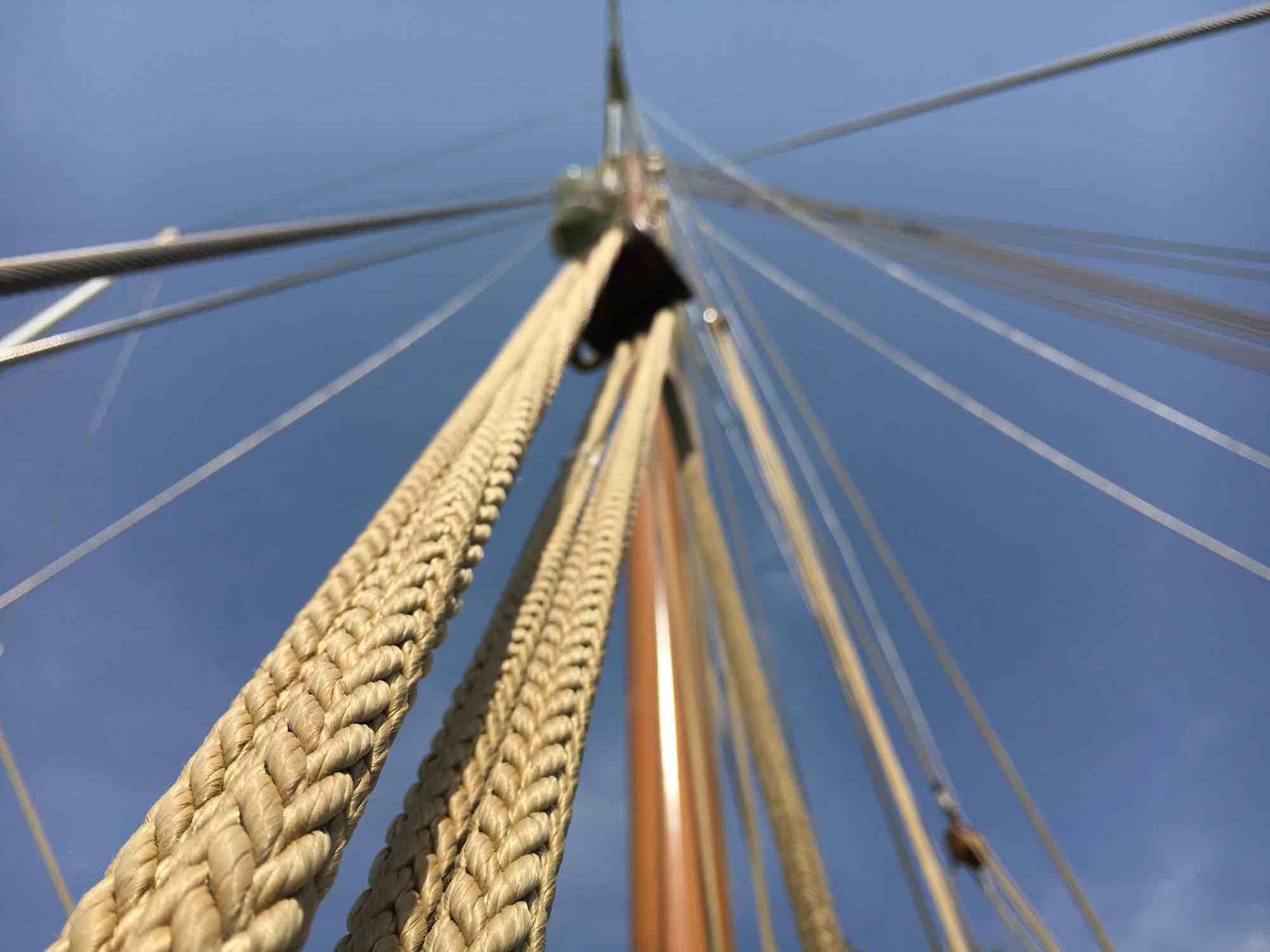 Dallinghoo_low angle shot of mast against blue sky yacht holiday in Mergui_XS.jpeg