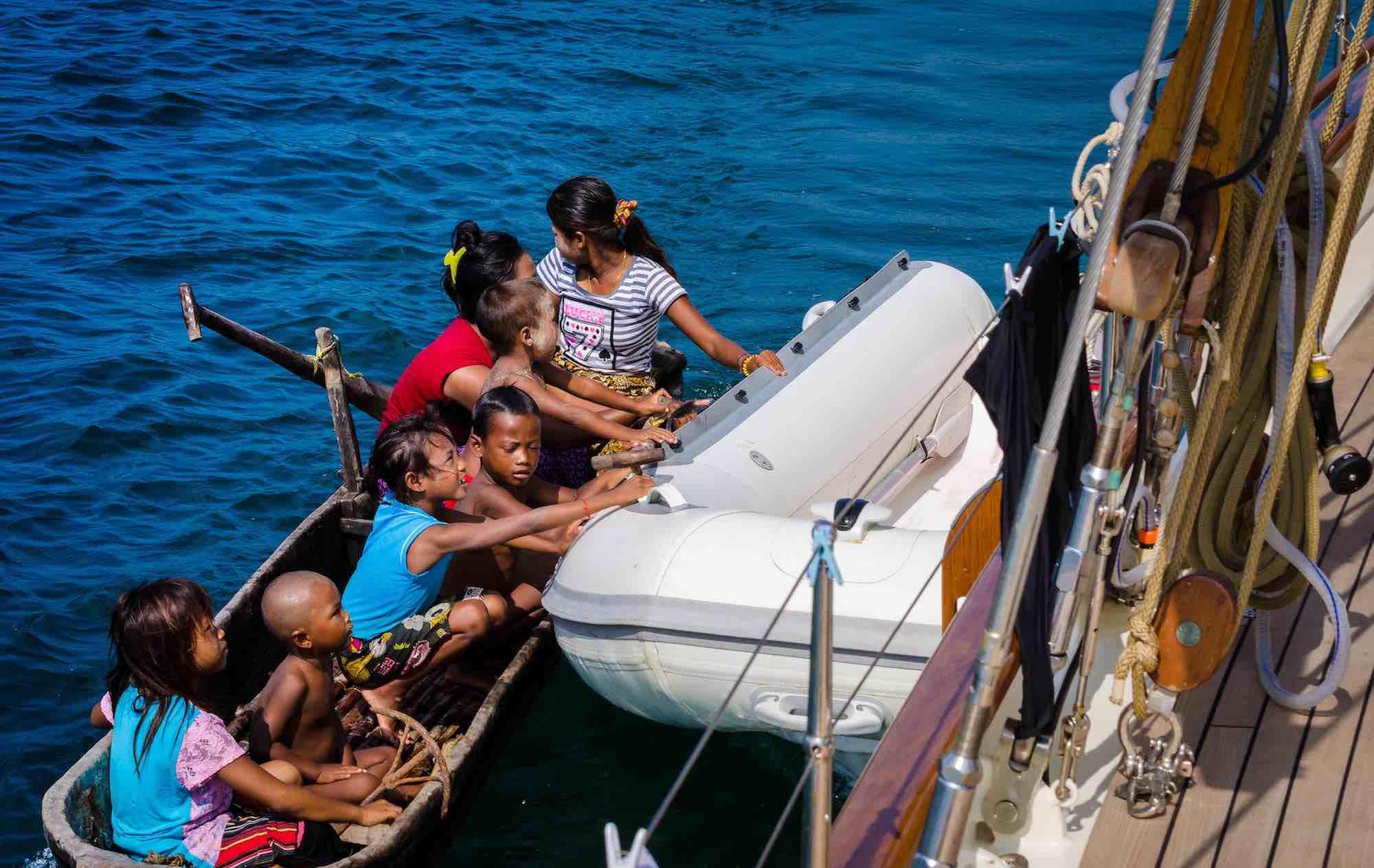 Dallinghoo_local kids holding on to yacht tender sailing trip in Mergui_XS.jpeg
