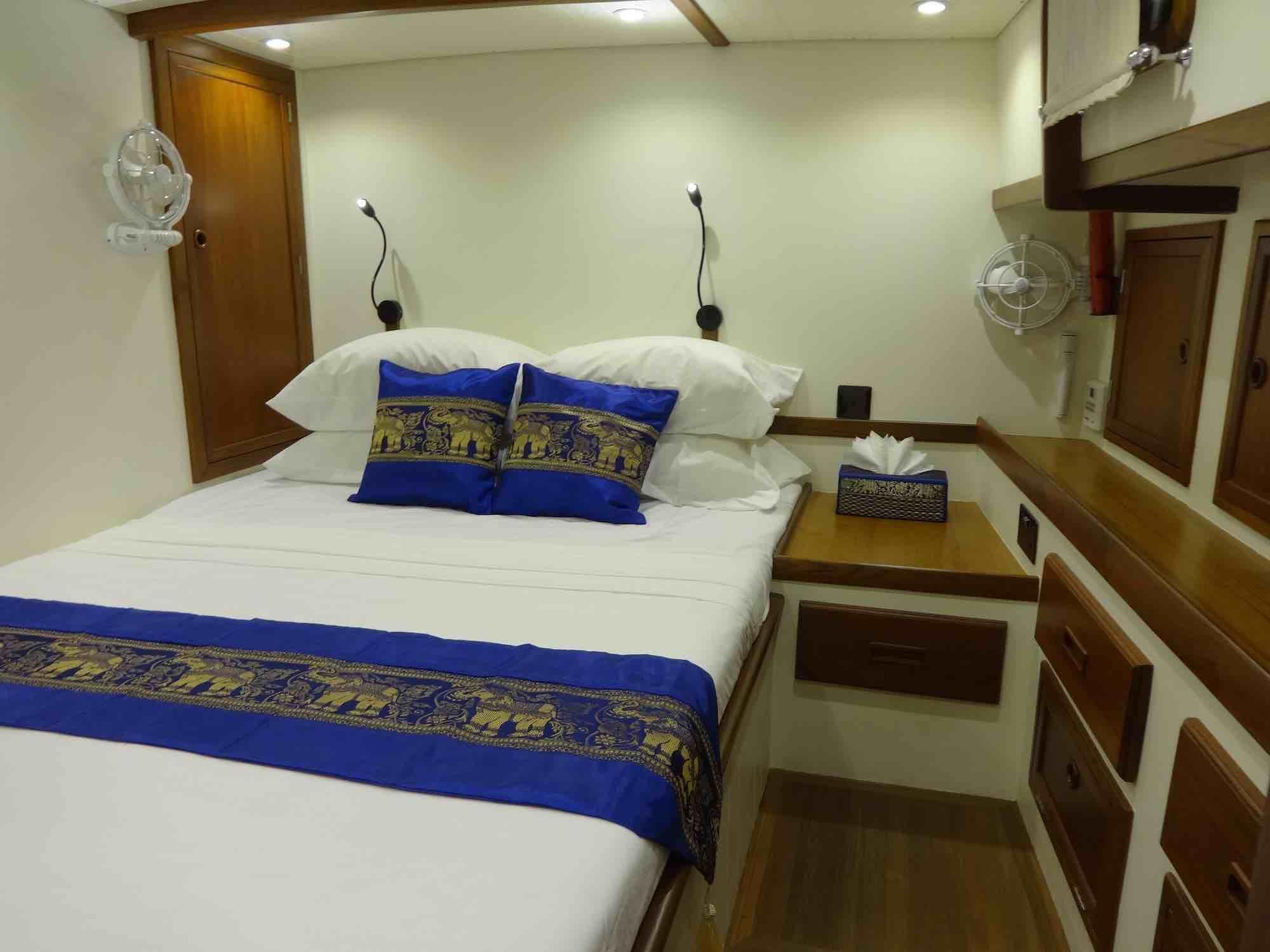 Dallinghoo_guest cabin blue throw pillows yacht trip in Mergui_XS.jpeg