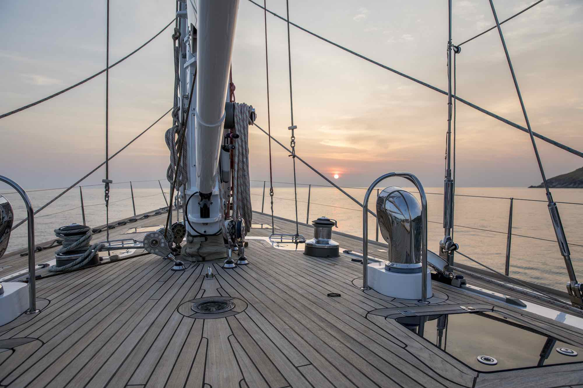 Aphrodite_bow deck sailing toward setting sun 1_XS.jpeg