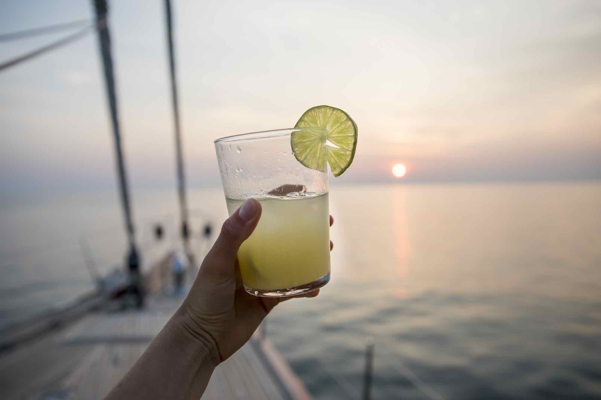 Aphrodite_have a fresh lemon drink as sun setting down boat trip in Thailand_XS.jpeg