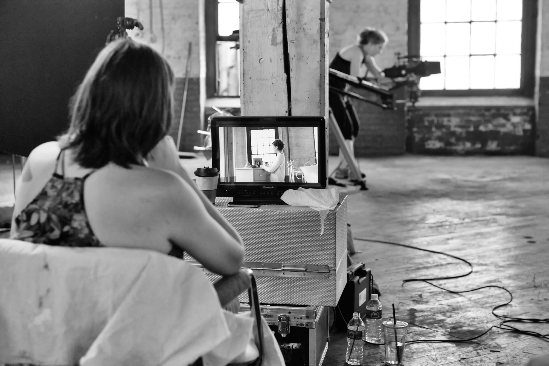 "Dana watching the monitor as photographer and videographer Tracy Birdsell films a scene in  ""Never Alone"""