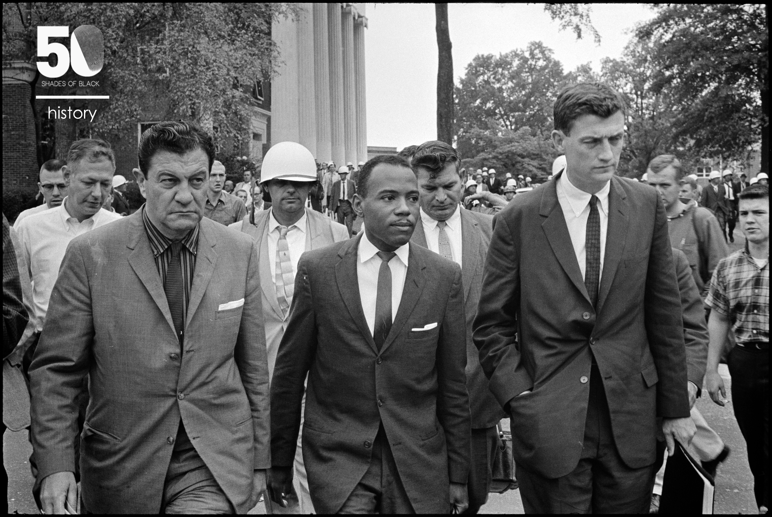 Integration at Ole Miss: James Meredith walking to class accompanied by U.S. marshals.The men flanking Meredith are U.S. Marshal James McShane (left) andJohn Doarof the Justice Department (right) October 1, 1962 Photographer:  Marion S. Trikosko for U.S. News & World Report Source: Library of Congress