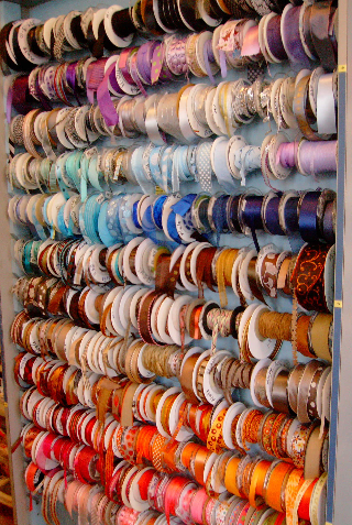 Part of The Papery's wall of ribbons by the yard.