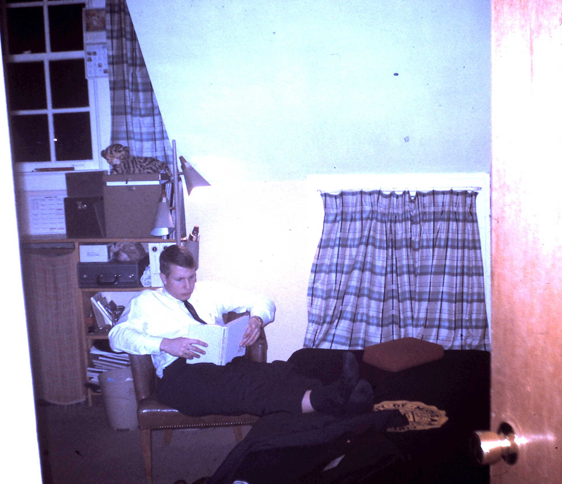 A Sigma brother (possibly John Moorhead '63) in his room at the chapter house, 1963