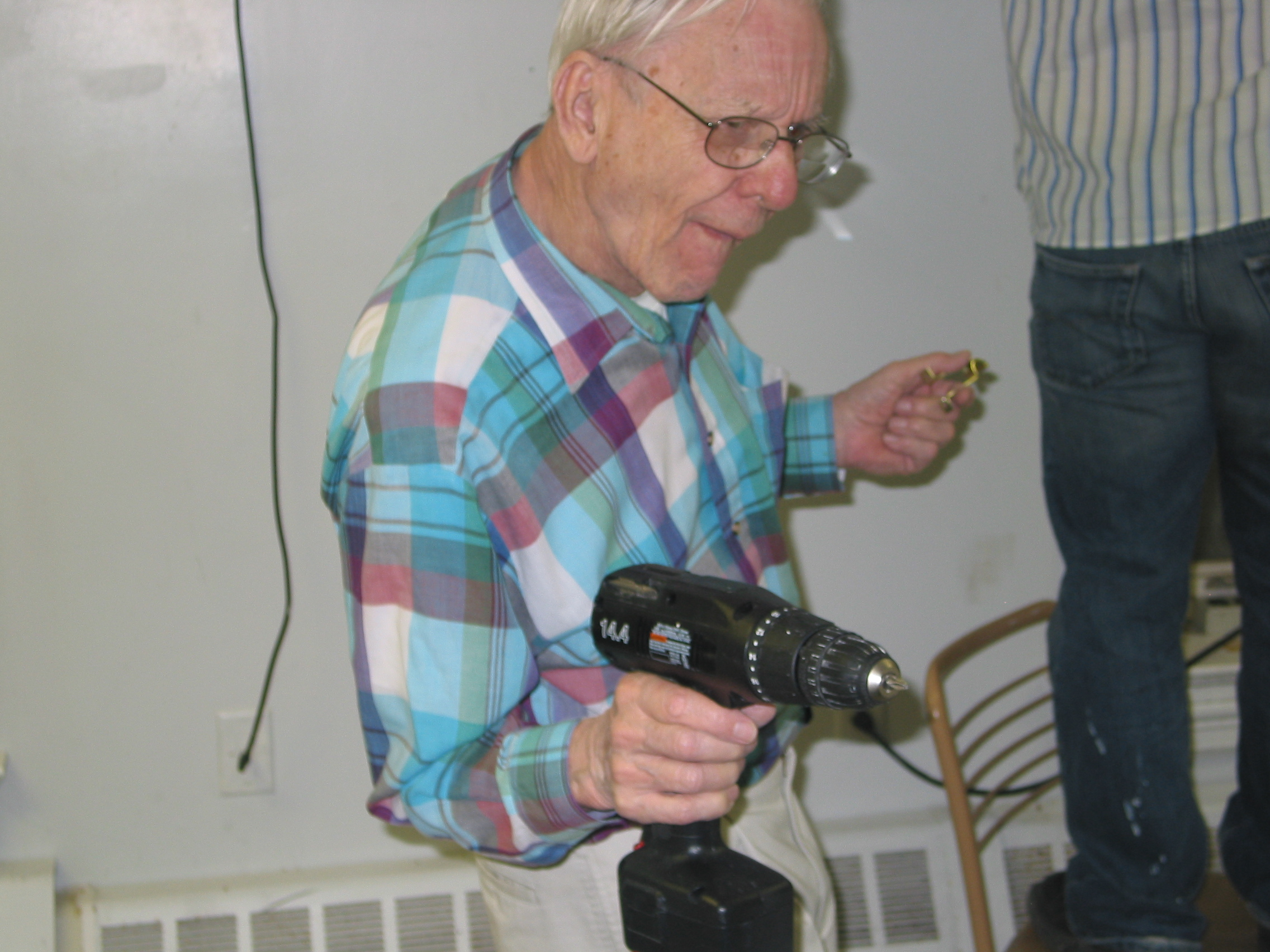 At the age of 81, helping set up Founders Day Brunch at Sigma's chapter house, 2005