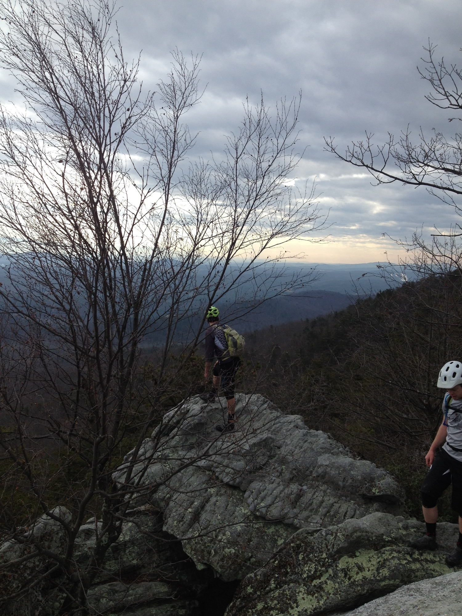 Collin Vento and Chase Lyne exploring one of the vertical rock spines jutting out of the mountain.