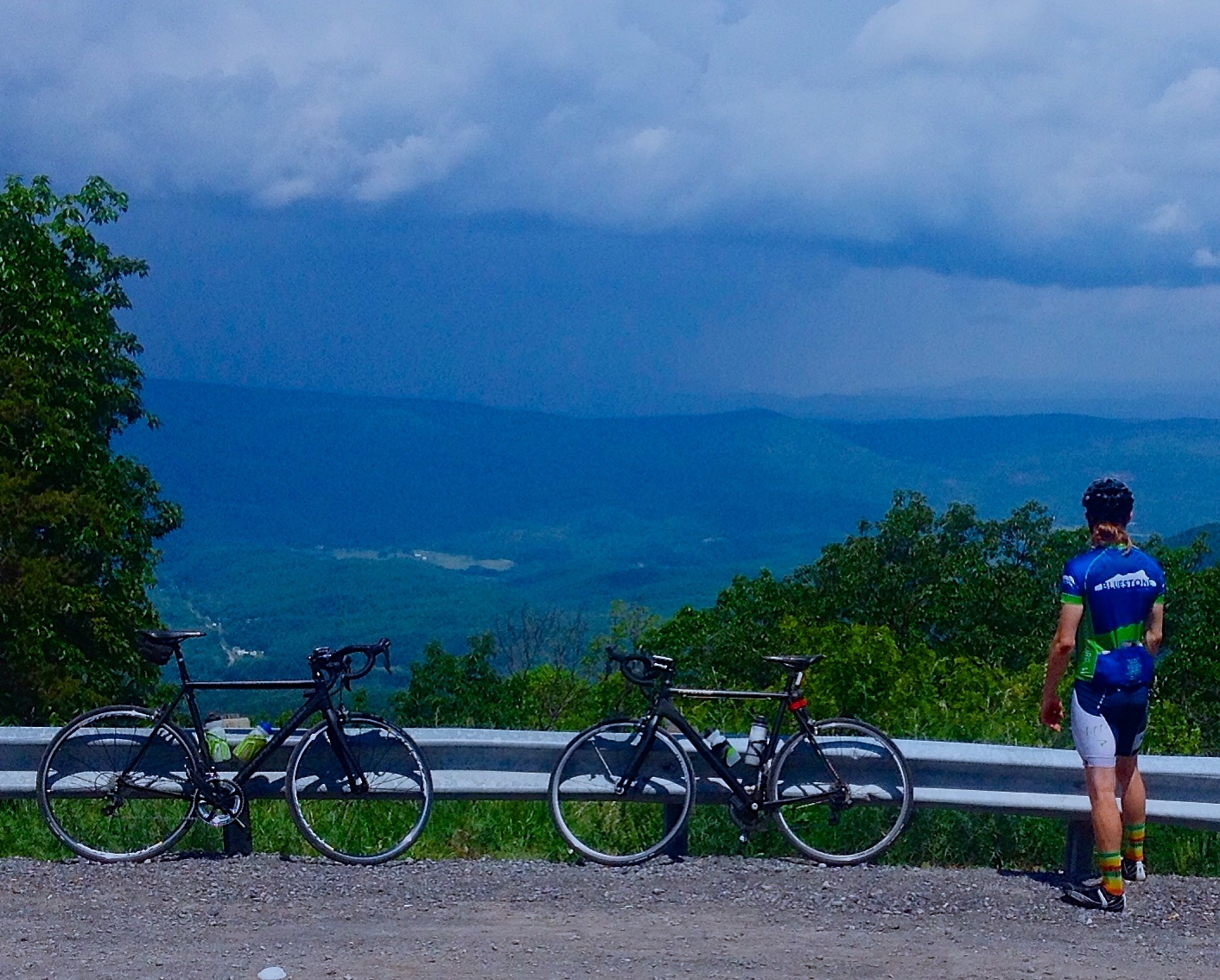David Taylor at the top of the climb on the state line looking west at the rains headed our way.