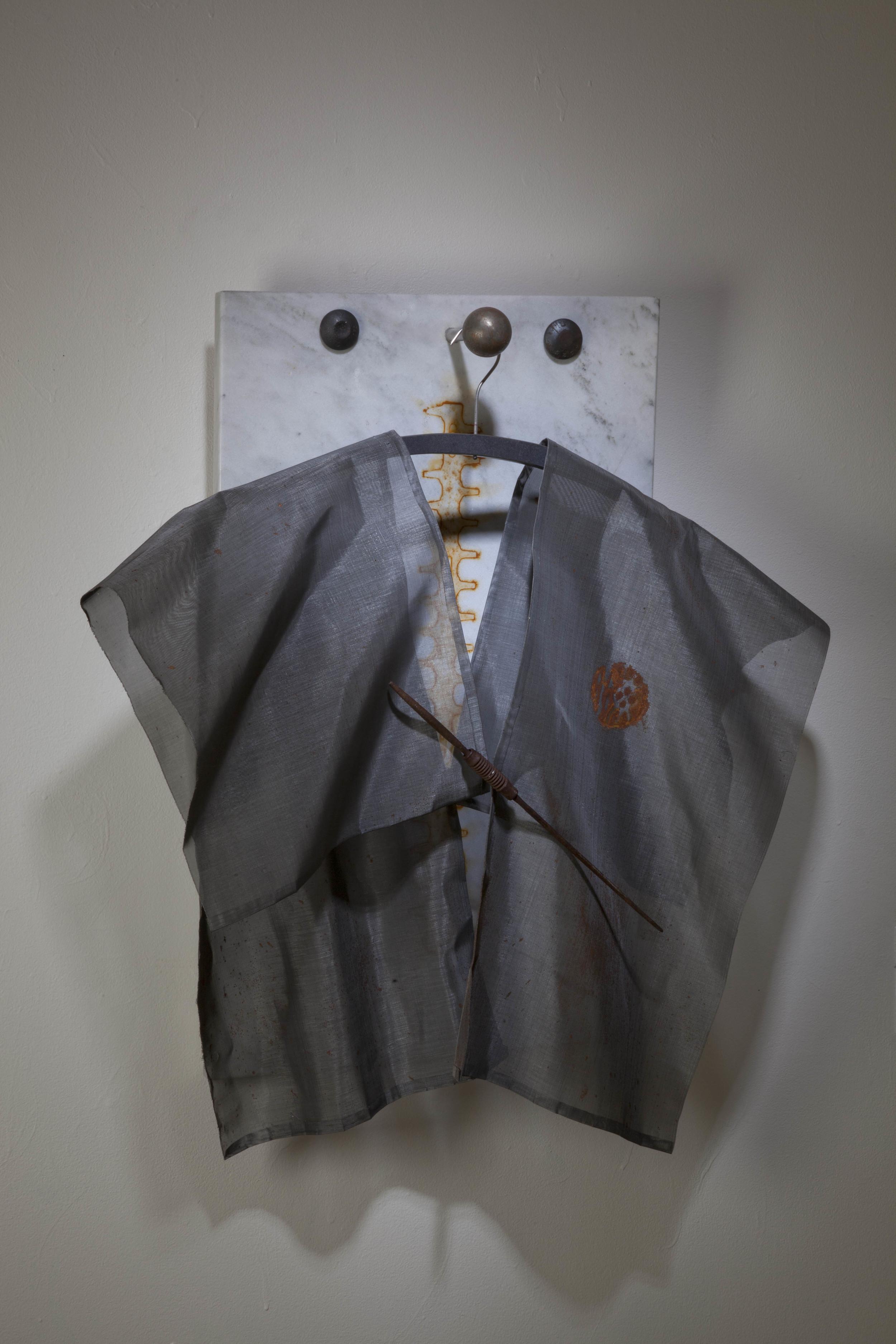 "Samurai,   Meris Barreto  30""x18""x5"",steel mesh, marble."