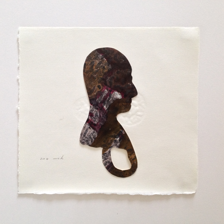 Ring-head 2004 cut paper on print .JPG