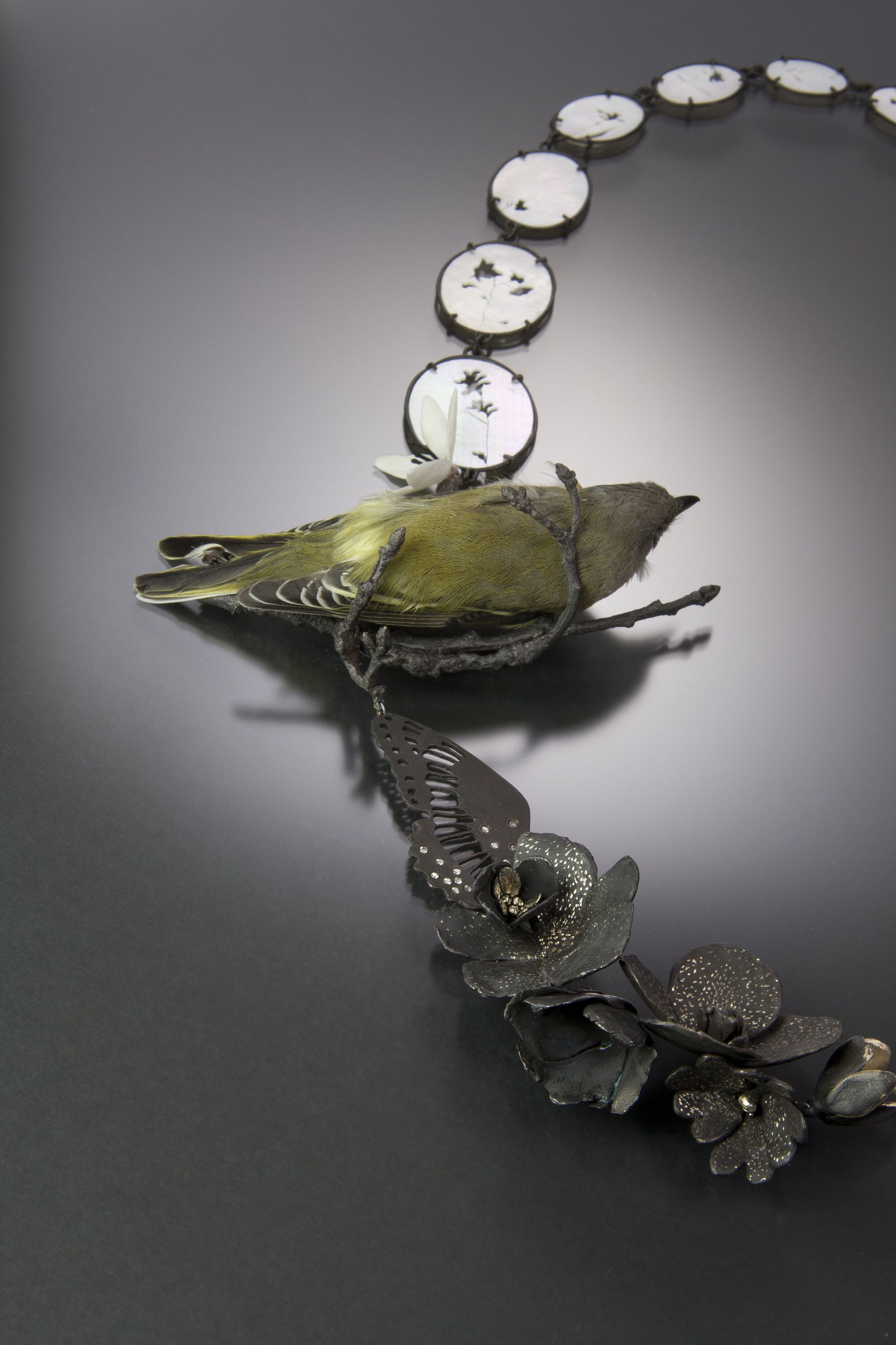 """Two Birds (detail)    Kelly Jean Conroy, 2013  20"""" x 8"""" x 1.5""""  Sterling silver, bronze, copper, bone, mother-of-pearl, cubic zirconia, preserves vireo, sparrow skeleton"""