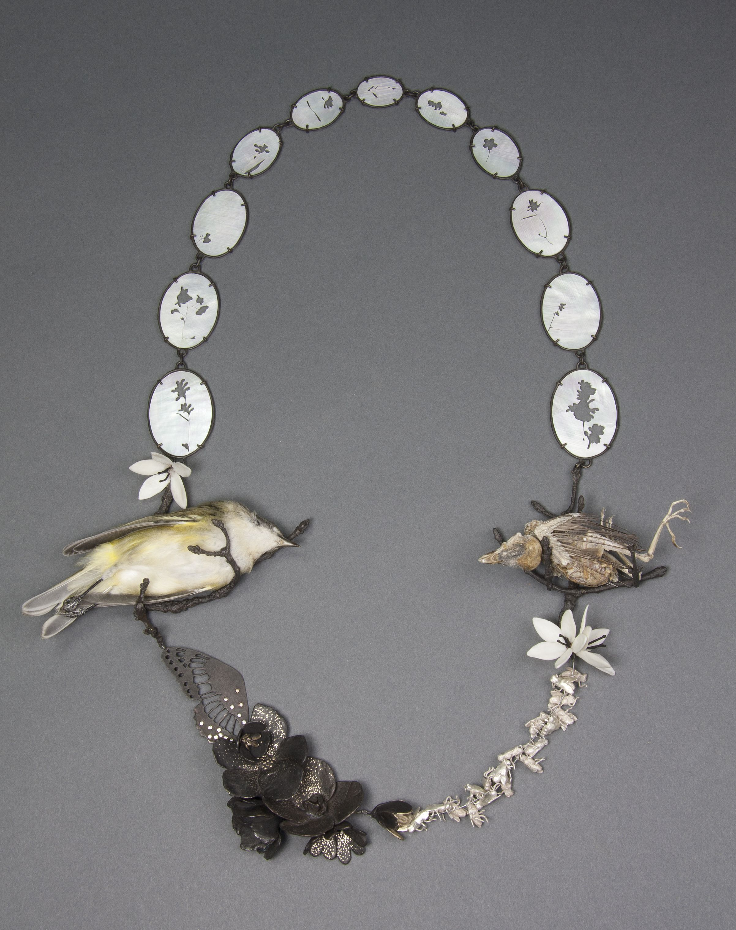 """Two Birds    Kelly Jean Conroy, 2013  20"""" x 8"""" x 1.5""""  Sterling silver, bronze, copper, bone, mother-of-pearl, cubic zirconia, preserves vireo, sparrow skeleton"""