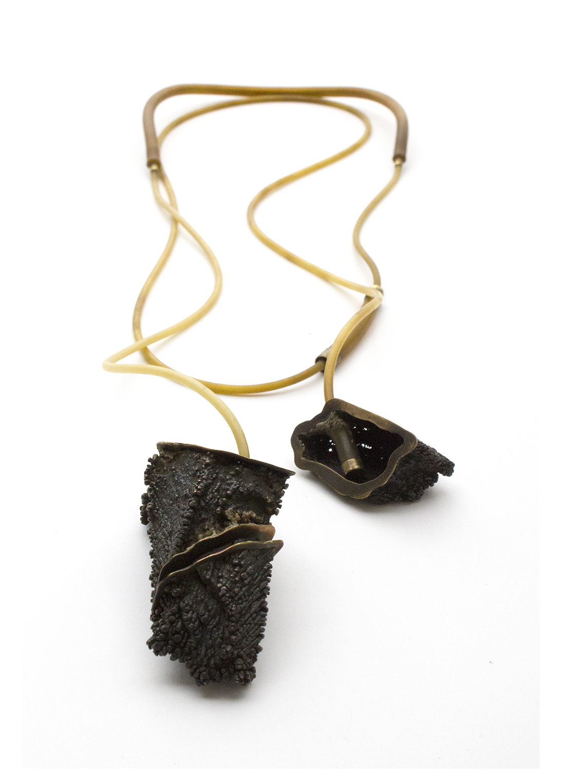 """Abandoned Series #1    Rene Henry, 2014  20 1/2"""" x 5 1/2"""" x 1 1/4""""  Copper, brass, natural rubber"""