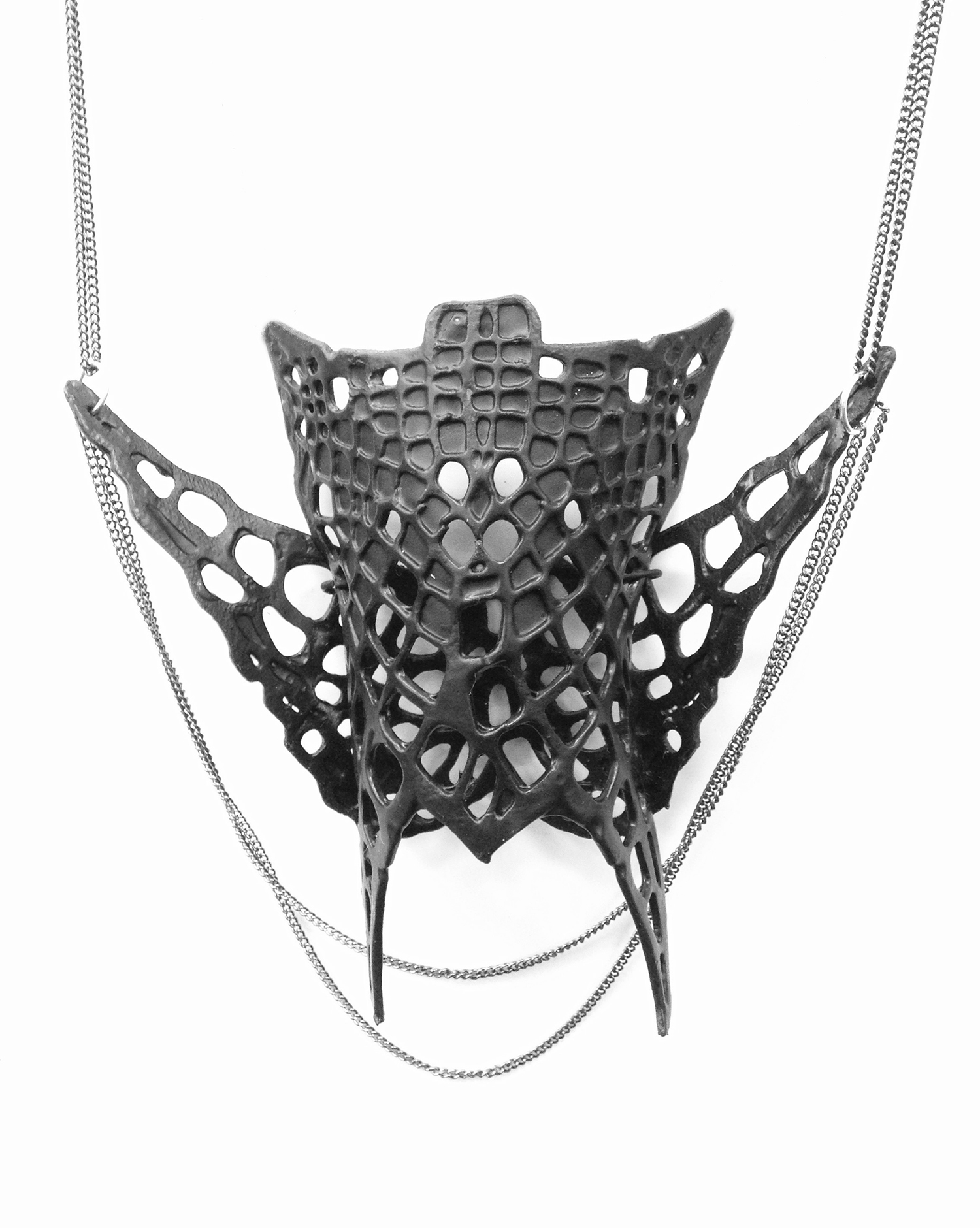 Skin  , 1 of 5 in a series  Tamar Navama, 2015  Various sizes, set of 5  Silver, plastic, paper, iron; gold mesh, goldfield