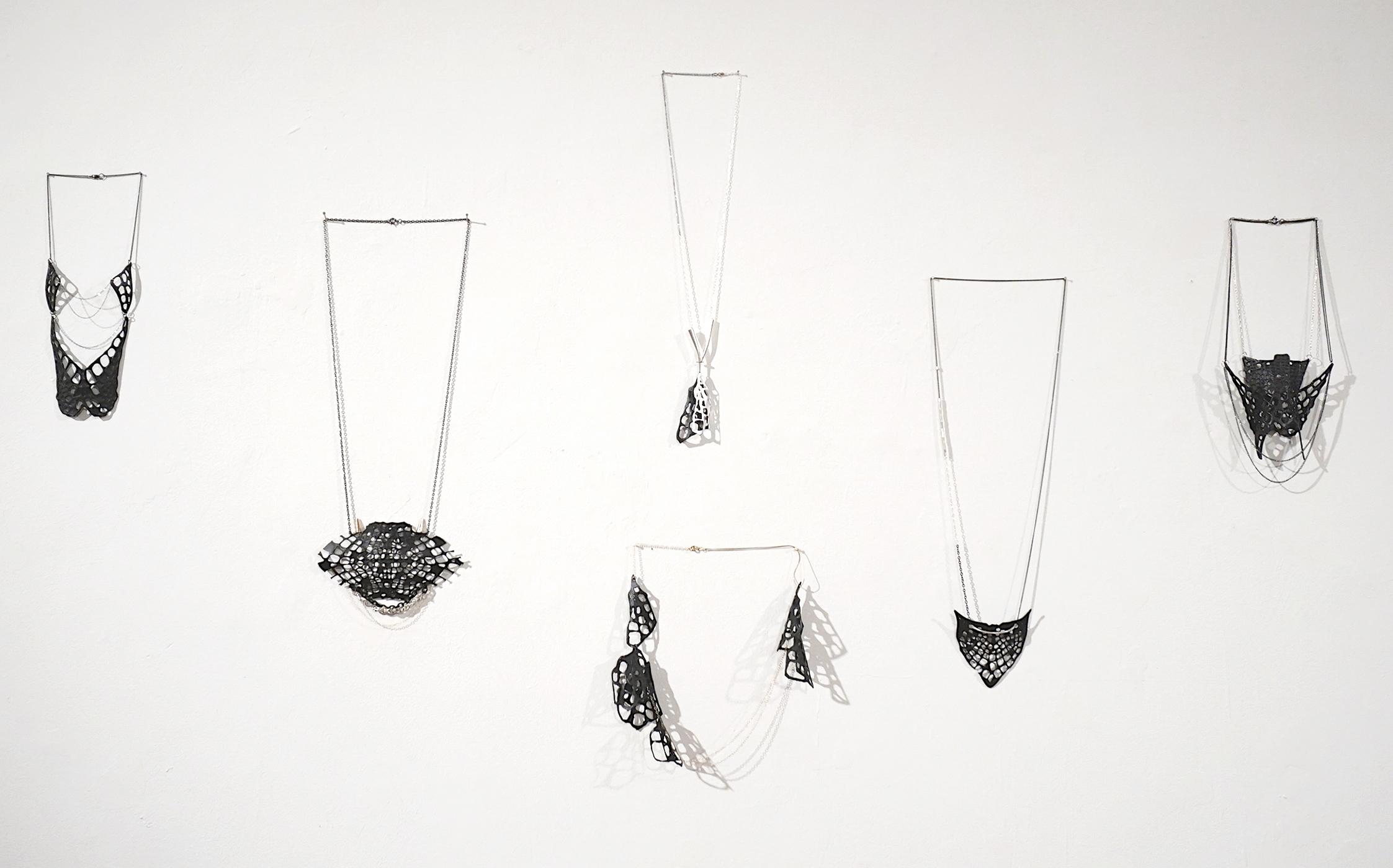 Skin    Tamar Navama, 2015  Various sizes, set of 5  Silver, plastic, paper, iron; gold mesh, goldfield
